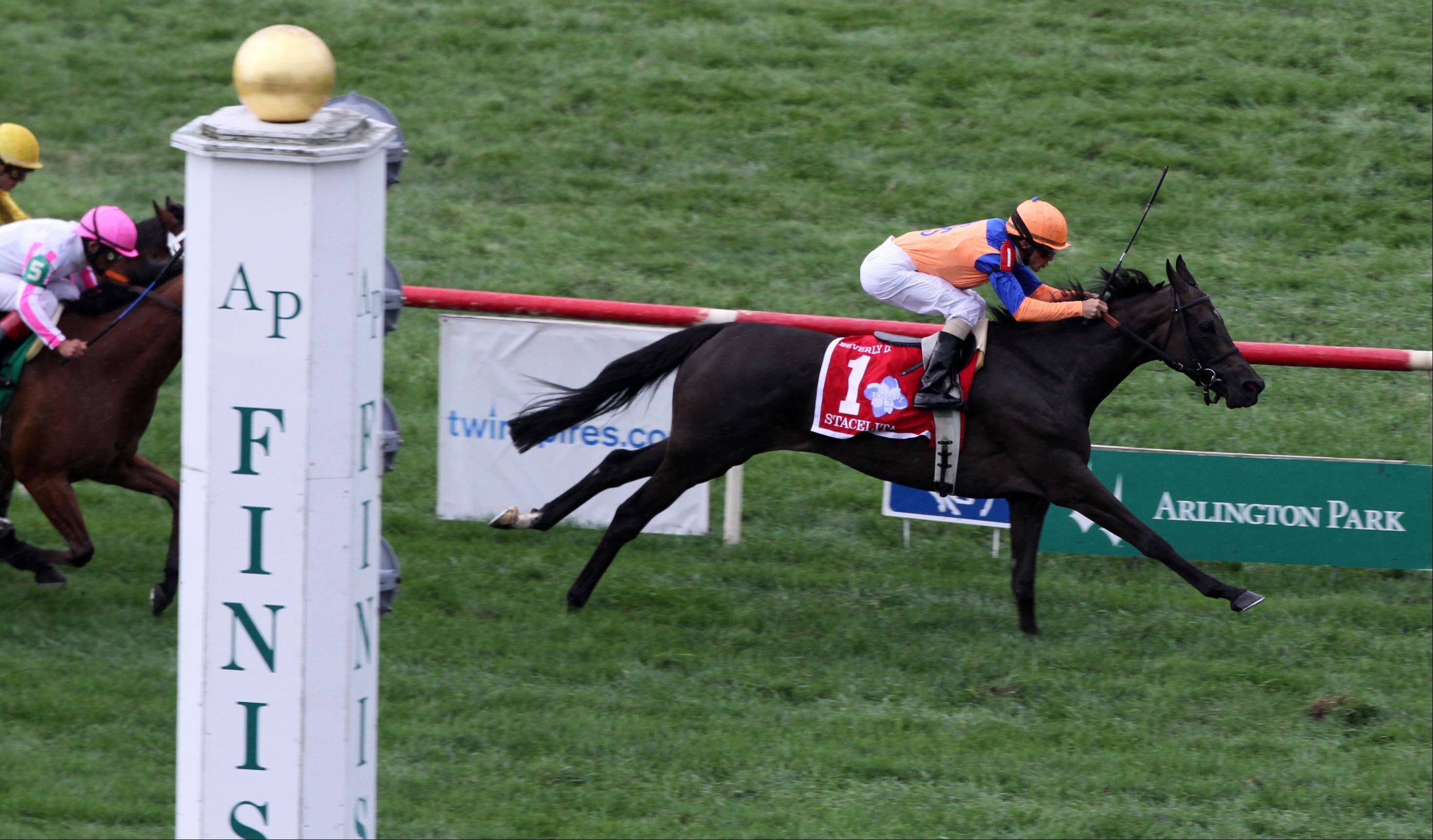 Ramon Dominguez, riding Stacelita, won the Beverly D. at Arlington Park on Saturday.