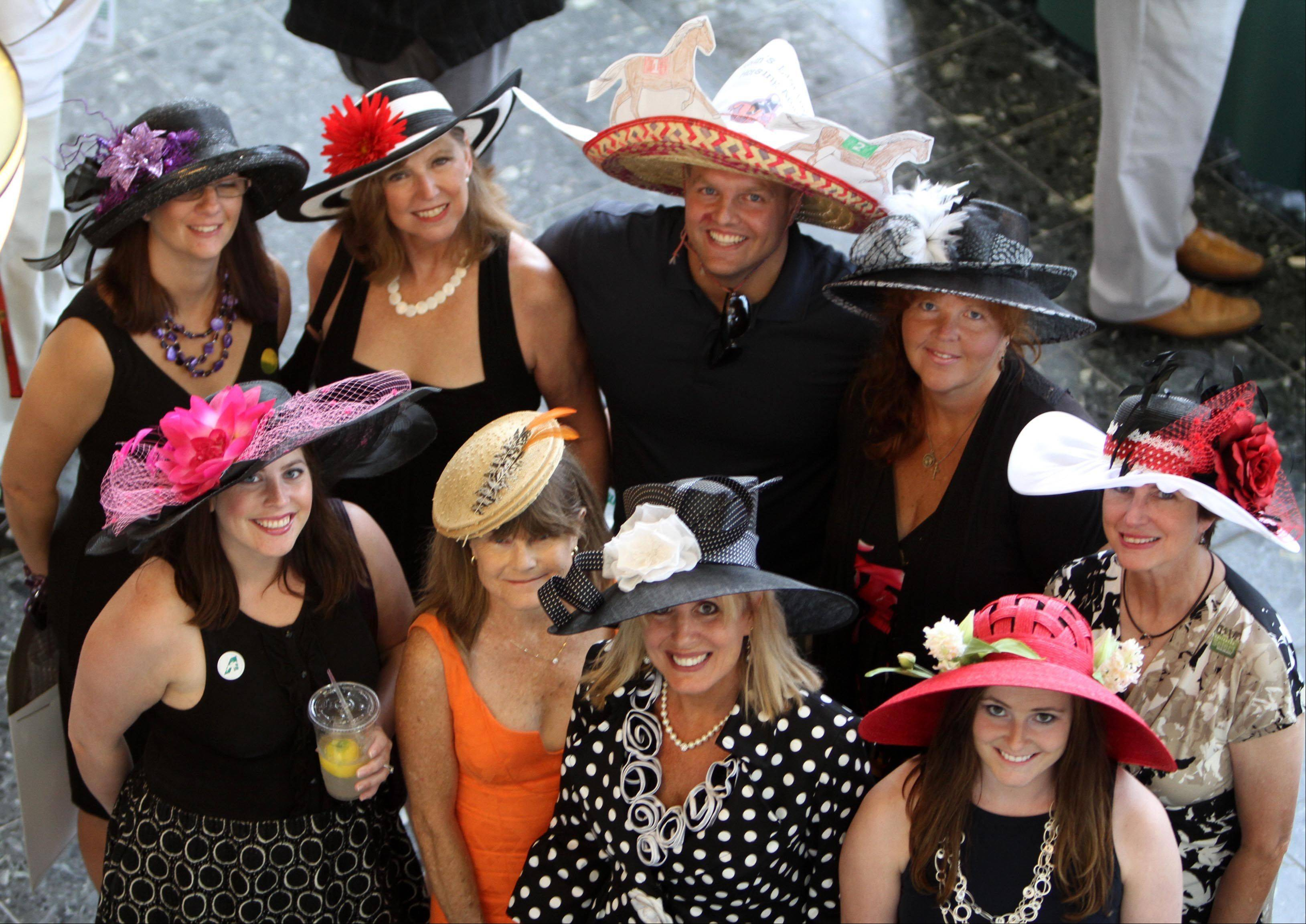 A group entering the hat contest pose before the Arlington Million at Arlington Park on Saturday.
