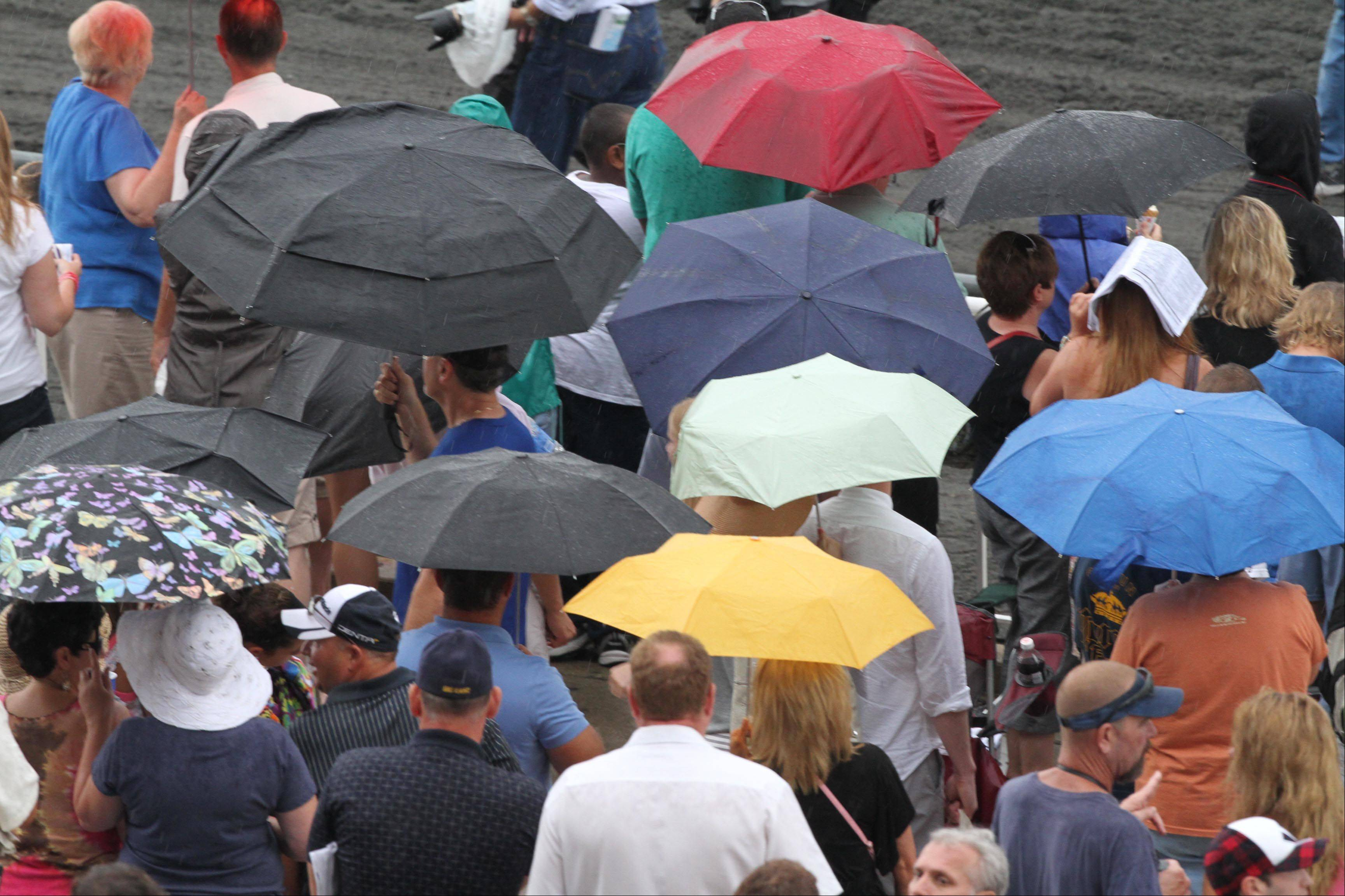Rain fell for most of the day at the Arlington Million at Arlington Park on Saturday.