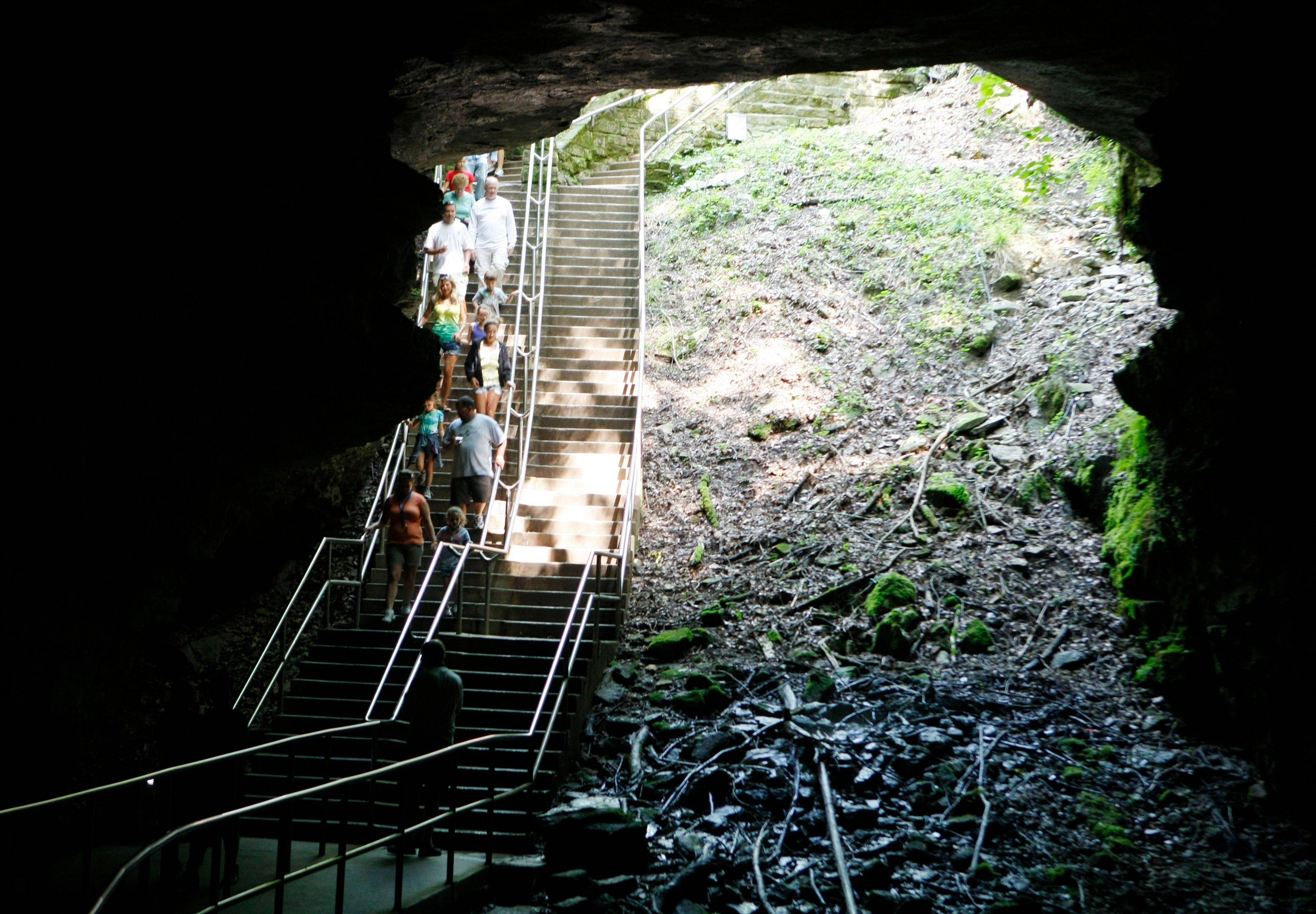 Tour participants enter Mammoth Cave in Mammoth Cave National Park, Ky. The celebrated cave that has lured the curious for thousands of years remains a temperate 54 degrees year-round.