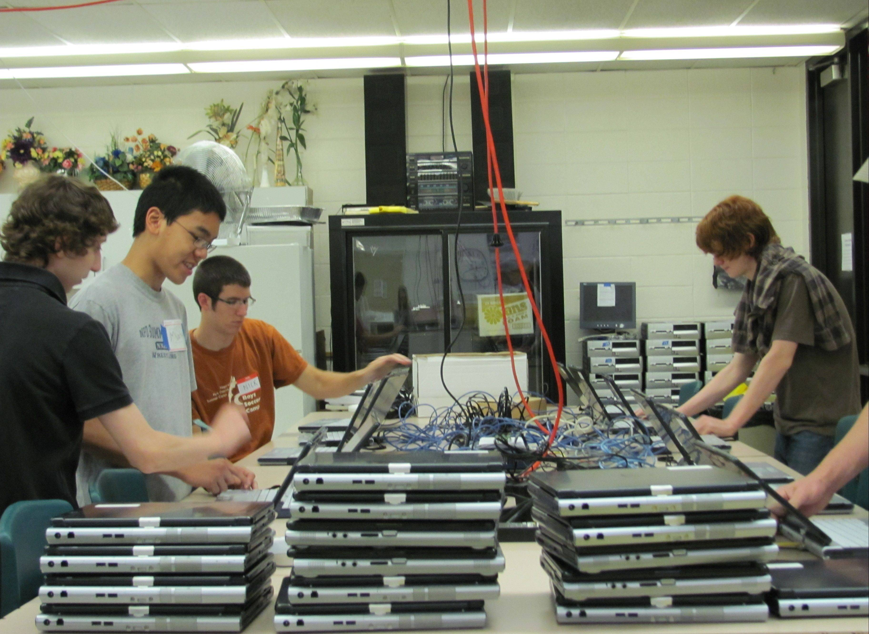 Students Devin Stompanato, Matthew Du, Nick Nelson and Nathan Campbell helped refurbish more than 700 laptop computers this summer.