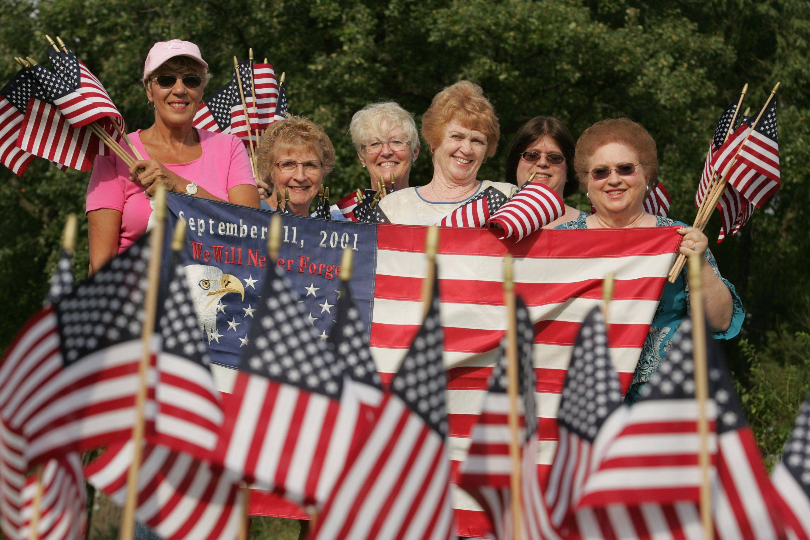 Several Sun City women have started a 9/11 memorial flag project and plan to place more than 3,000 flags out for the 10th anniversary. From left are Linda Bahwell, Barb Soracco, Peg Mulhall, Catherine Portera, Michele Neigebauer and Mary Neigebauer.