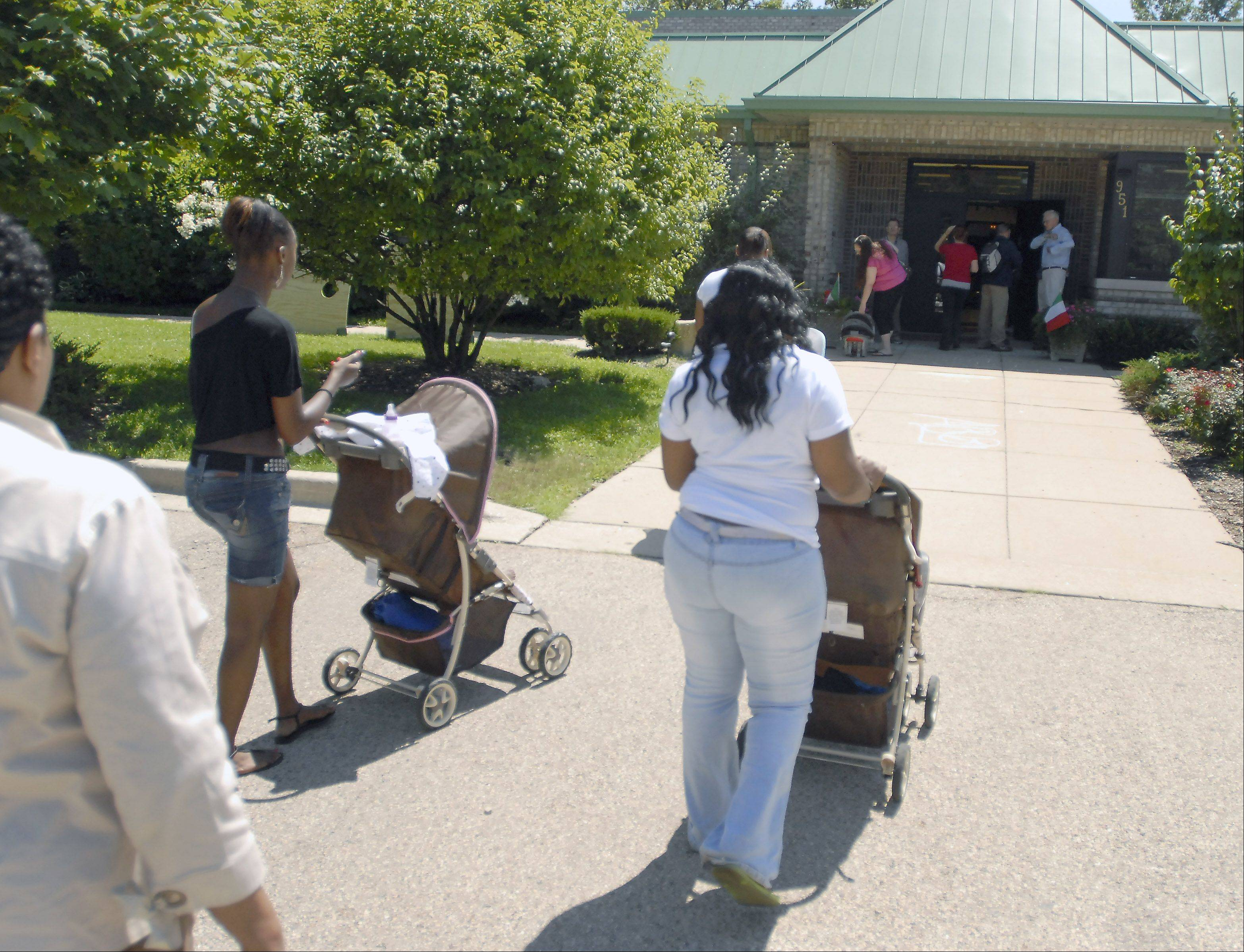 Making their way to the Family and Friends Day celebration, these teen mothers learn to take care of themselves and their babies at Casa Imani, Maryville Academy's group home in Bartlett for girls who have mental illnesses and are pregnant or have babies.