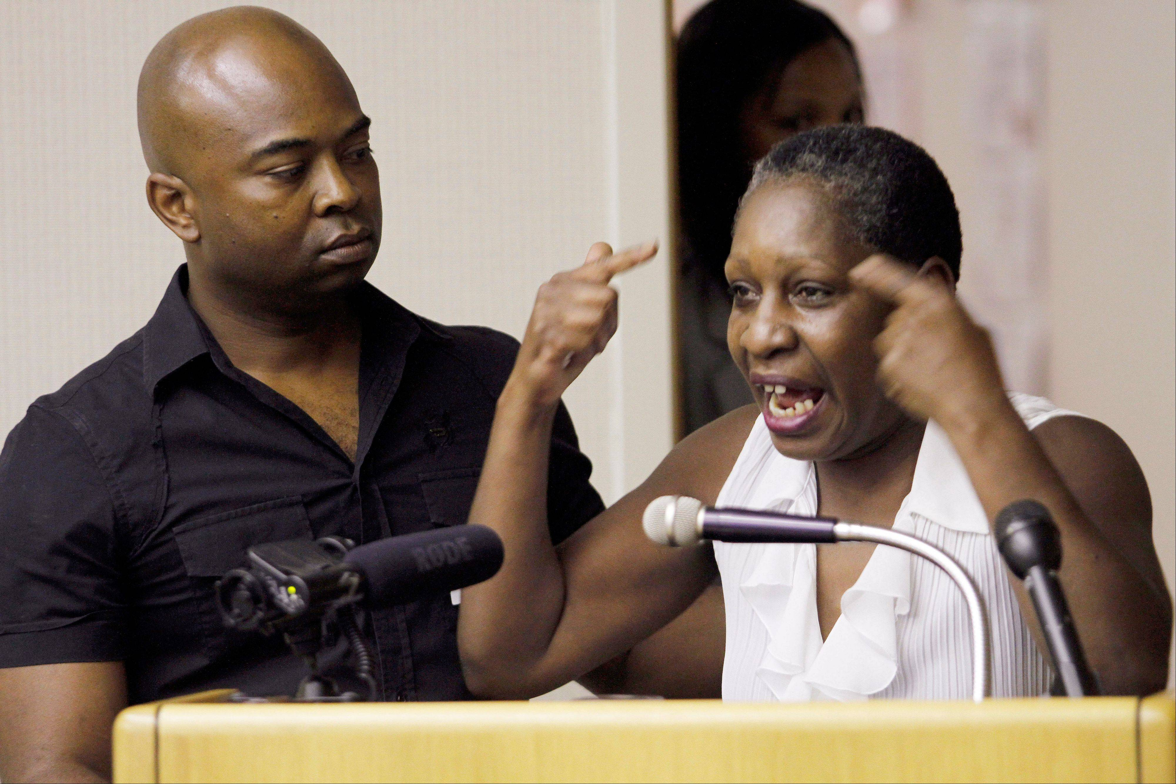 Elaine Riddick is comforted by her son, Tony, as she testifies before the Justice for Sterilization Victims Foundation task force compensation hearing in Raleigh, N.C. Victims of a state-sponsored sterilization program and their family members are urging a governor-appointed task force to recommend financial compensation for the suffering they endured under North Carolina's discontinued eugenics program.