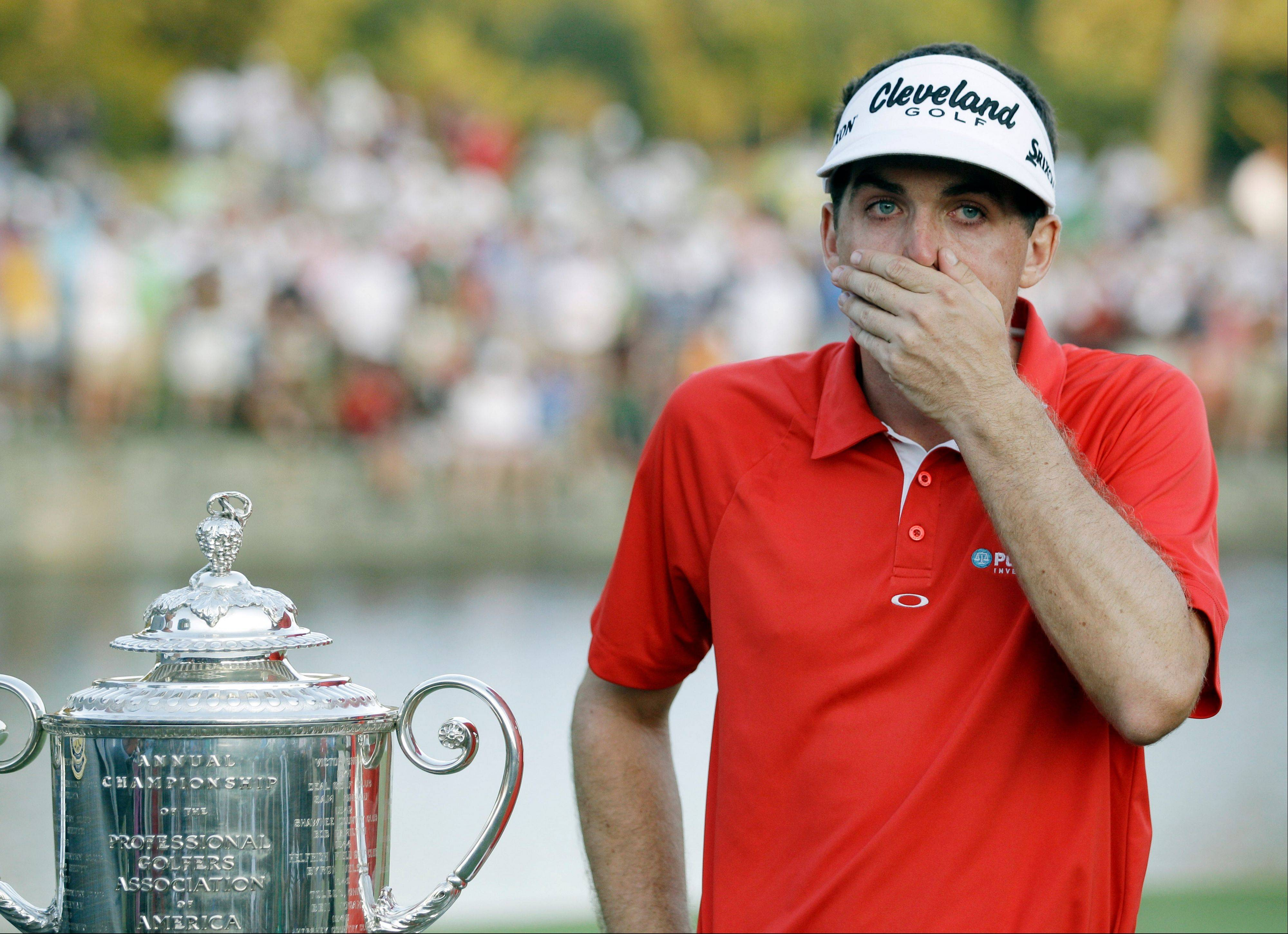 Keegan Bradley reacts with the Wanamaker Trophy on the 18th green Sunday after winning a three-hole playoff against Jason Dufner.