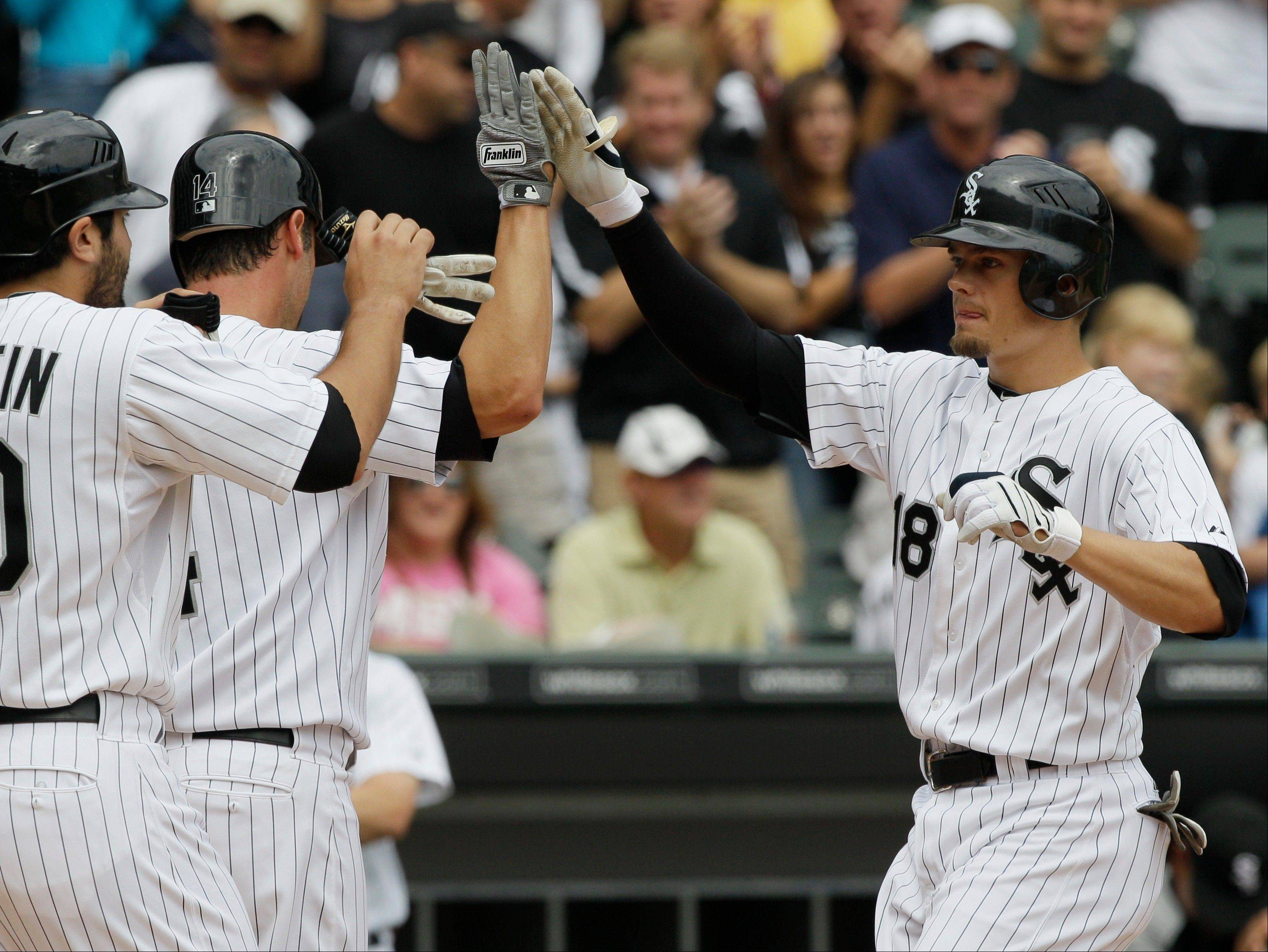 Brent Lillibridge, right, celebrates with Paul Konerko, middle, and Carlos Quentin after hitting a 3-run homer in the first inning Sunday.