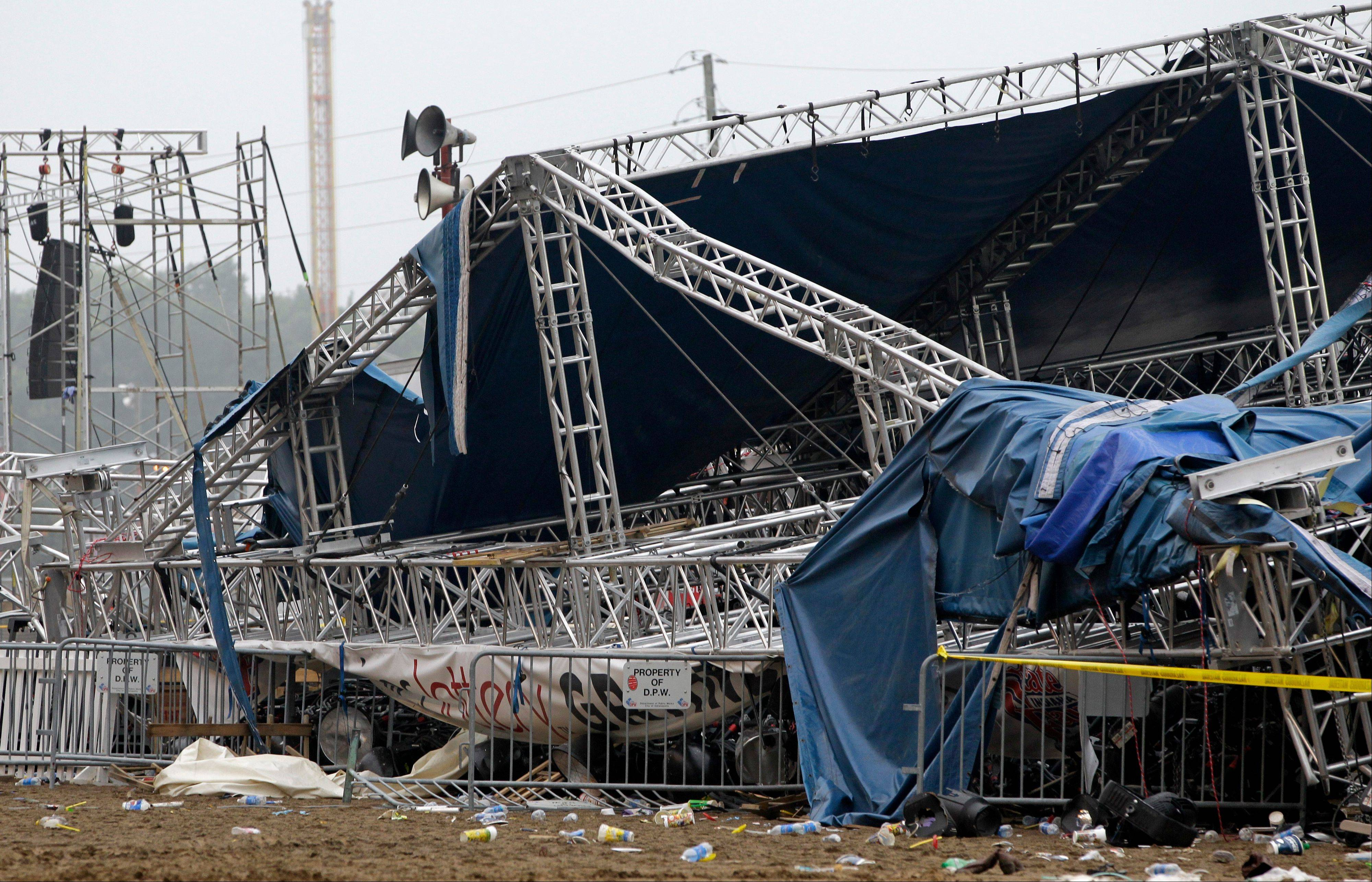 Indiana State Police and authorities survey the collapsed rigging and Sugarland stage on the infield at the Indiana State Fair in Indianapolis Sunday Aug. 14 2011. Five people died in the stage collapse.