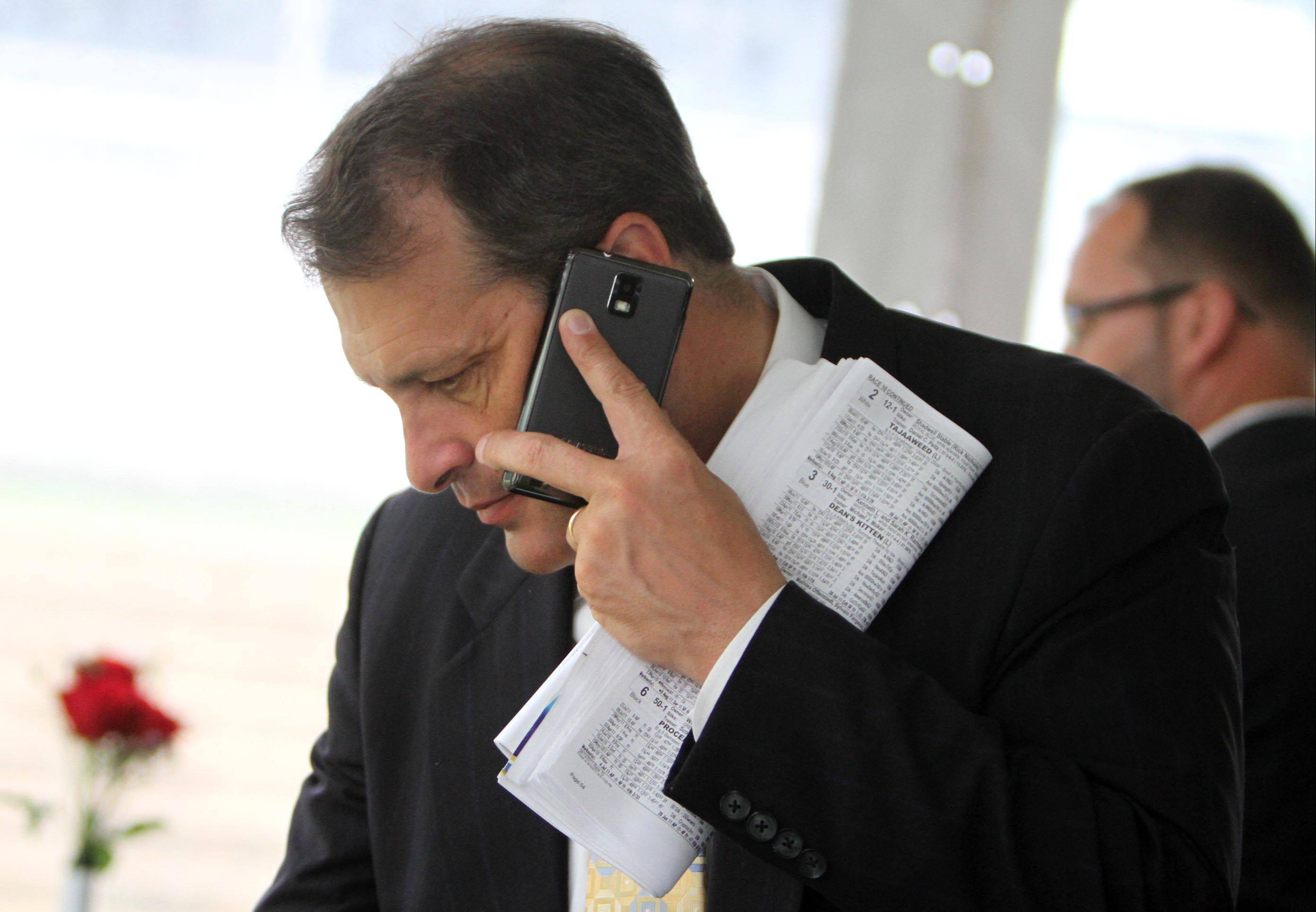 Tony Petrillo, general manager of Arlington Park, on the phone in the winners tent Saturday after the Arlington Million at Arlington Park.