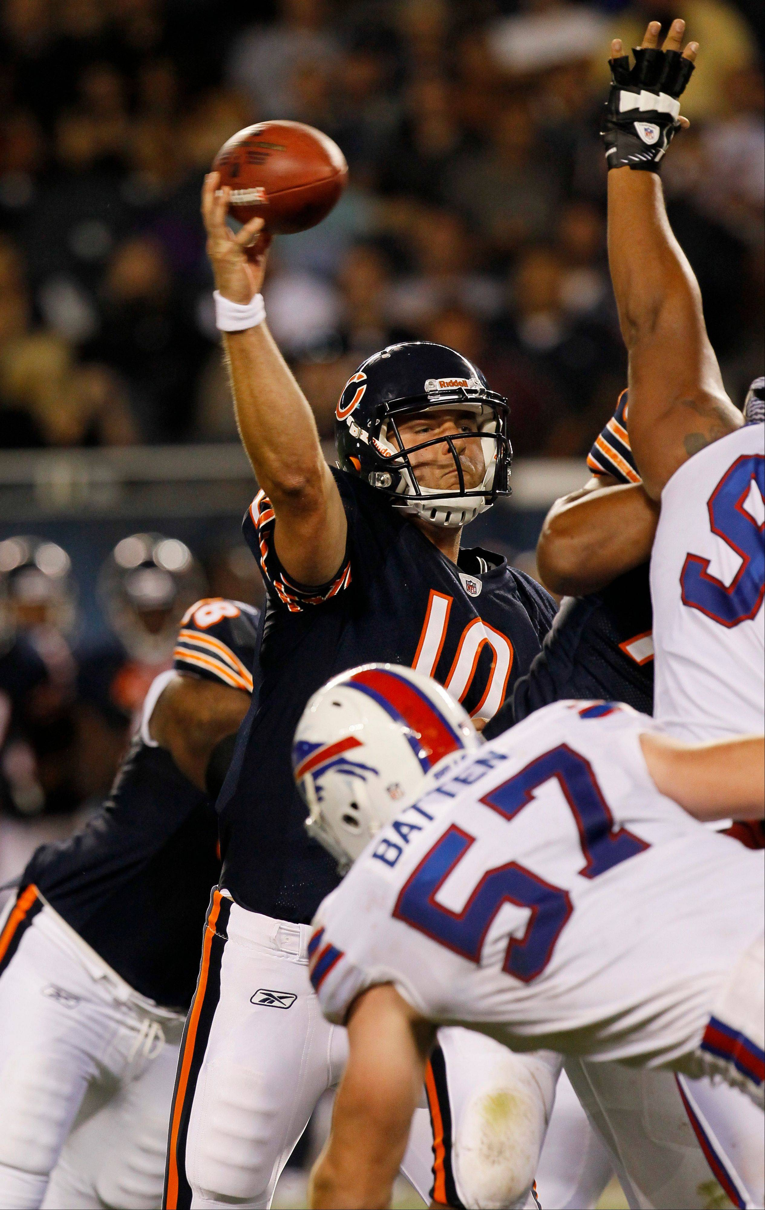 Chicago Bears quarterback Nathan Enderle (10) throws a pass under pressure from Buffalo Bills linebacker Danny Batten (57) in the second half an NFL preseason football game Saturday in Chicago.