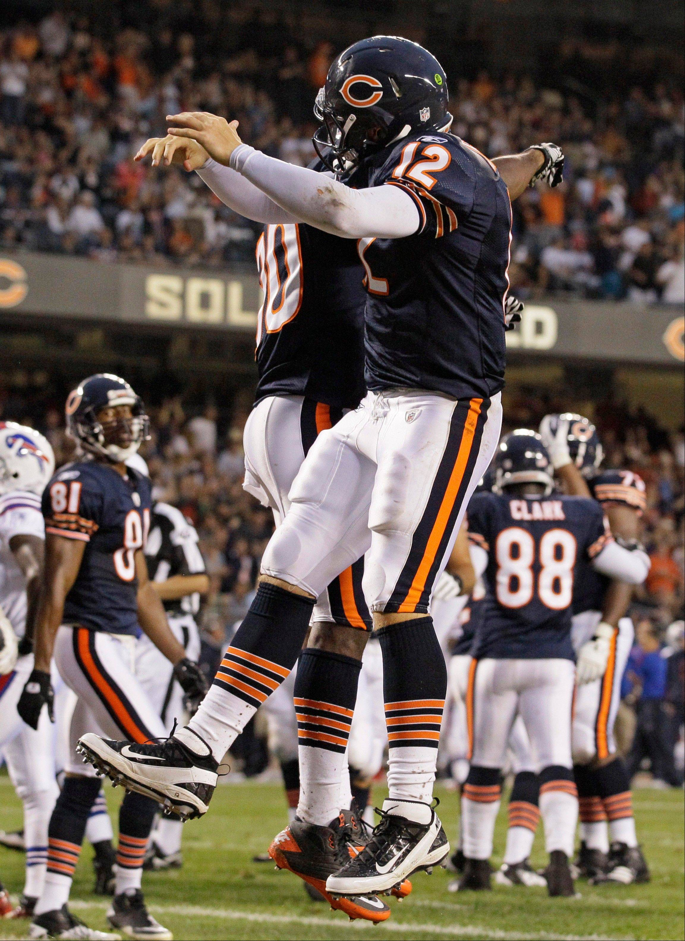 Chicago Bears quarterback Caleb Hanie (12) celebrates after scoring a touchdown with teammate Earl Bennett in the first half an NFL preseason football game Saturday against the Buffalo Bills game.