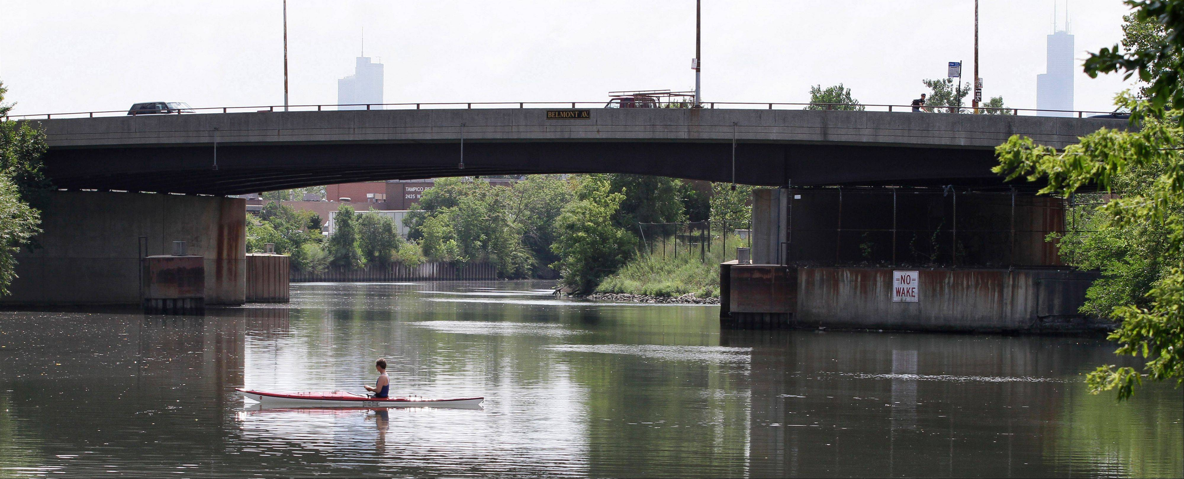 In this photo taken Aug. 23, 2010, a kayaker paddles along the Chicago River in Chicago. A new commission will ensure minorities and the poor aren�t disproportionately affected by environmental pollution.