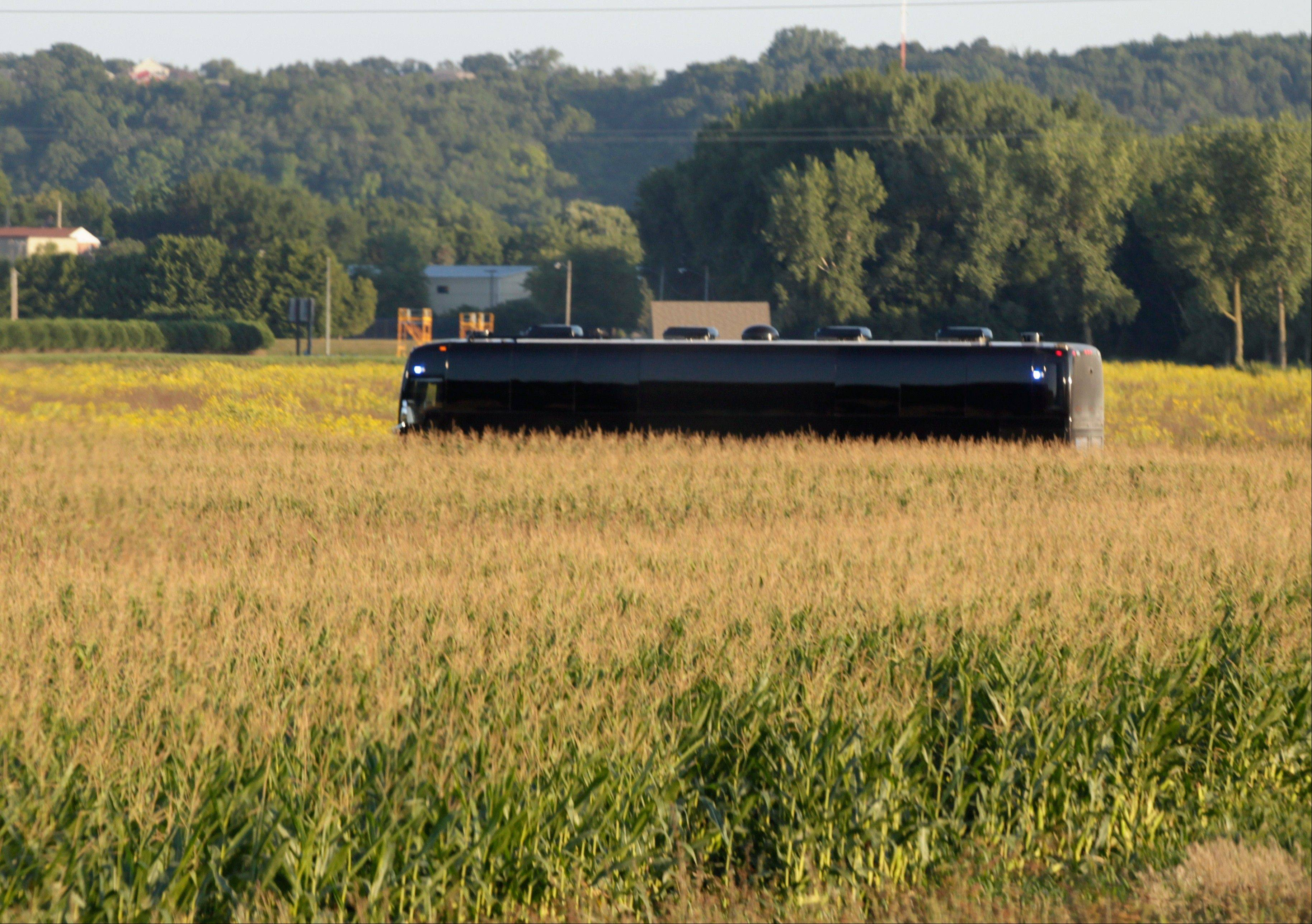 President Barack Obama�s bus drives among corn fields, Monday, Aug. 15, 2011, as it approaches Decorah, Iowa, during a three-day economic bus tour.
