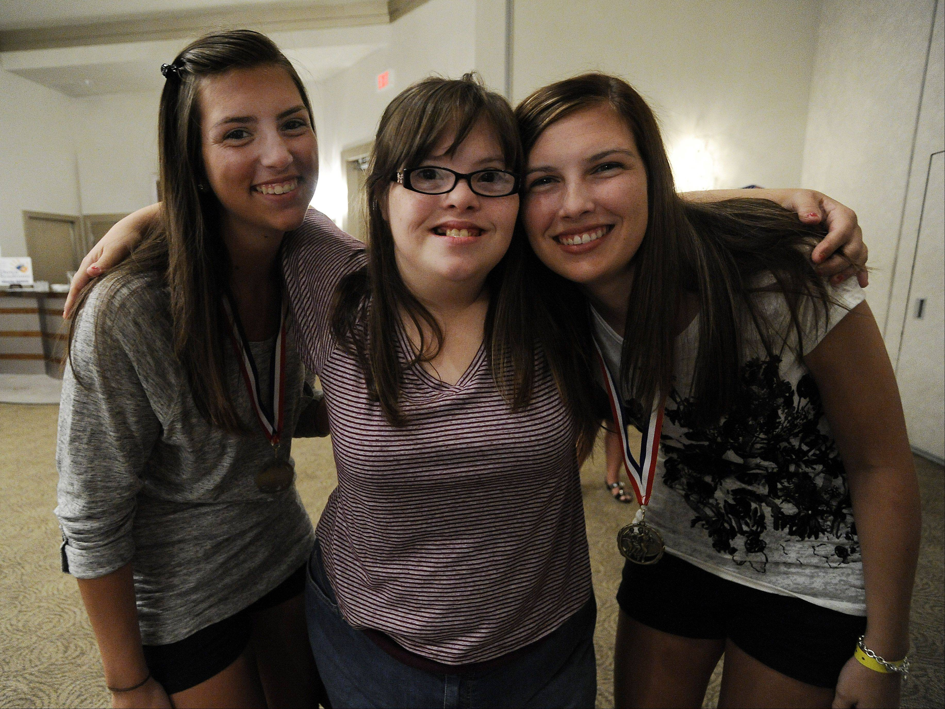 Kelsey Nolan, 17, center, is proud of her sisters, Lindsey, left, and Brittany, for participating in the Rock 'n Roll marathon.