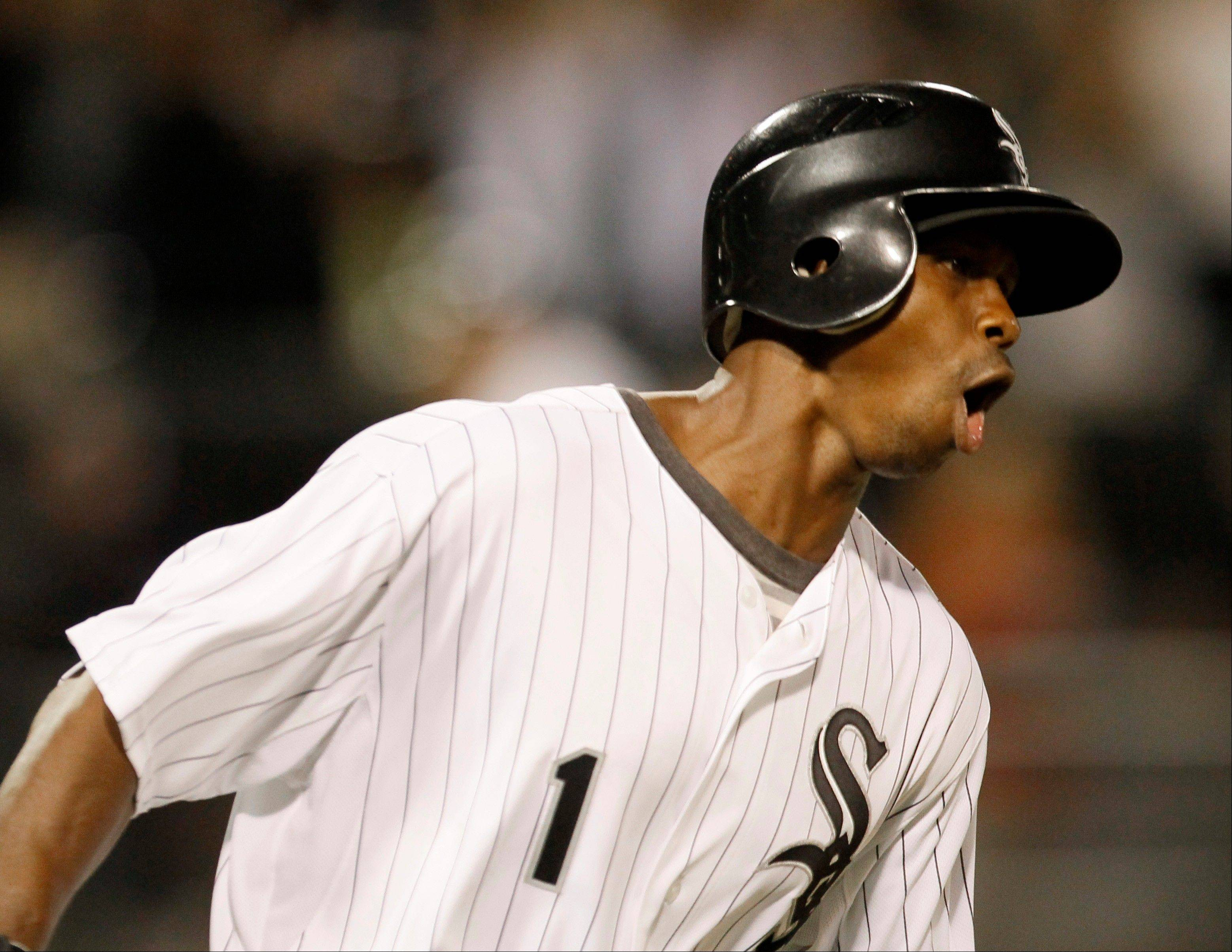 Juan Pierre celebrates his game-winning single off Cleveland�s David Huff, scoring Gordon Beckham in the 14th inning early Wednesday in Chicago. The White Sox won 8-7.