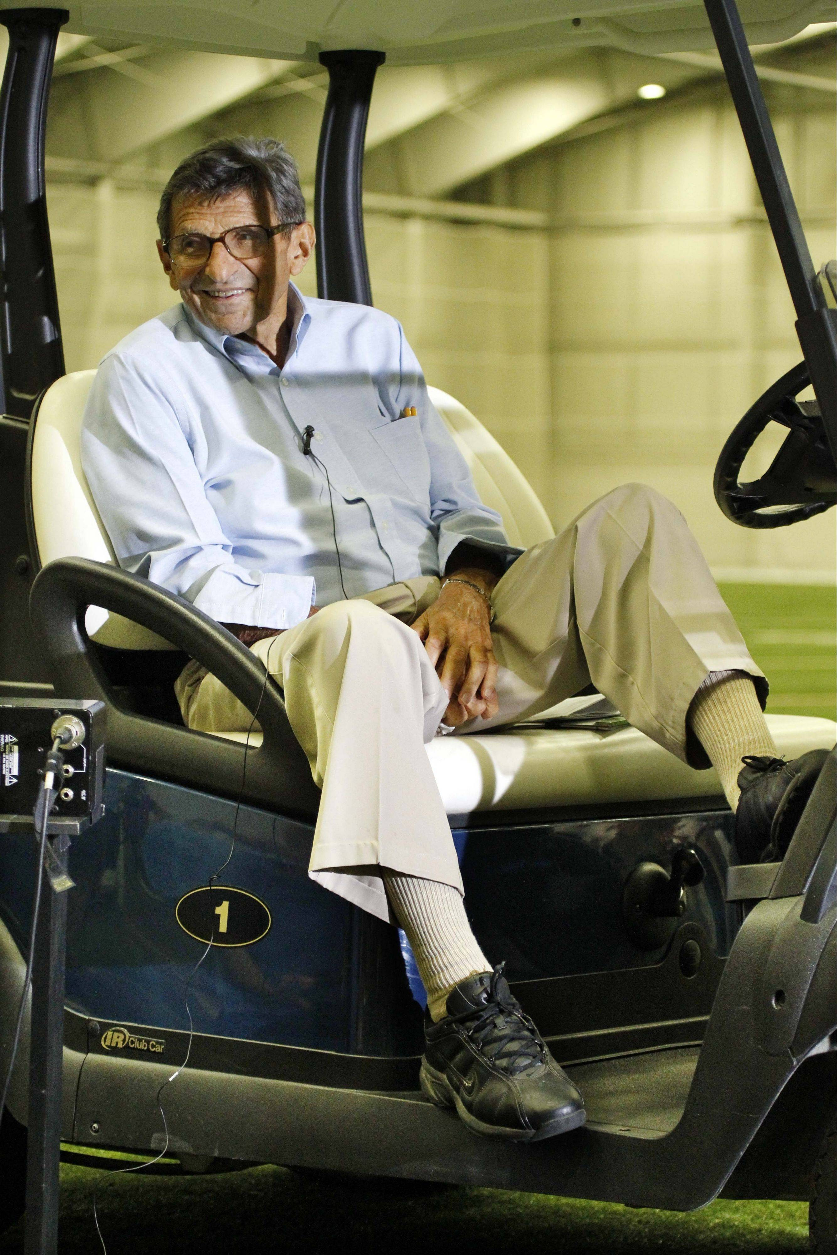 Penn State coach Joe Paterno holds a news conference from his golf cart at the school�s indoor football training facility during media day Tuesday.