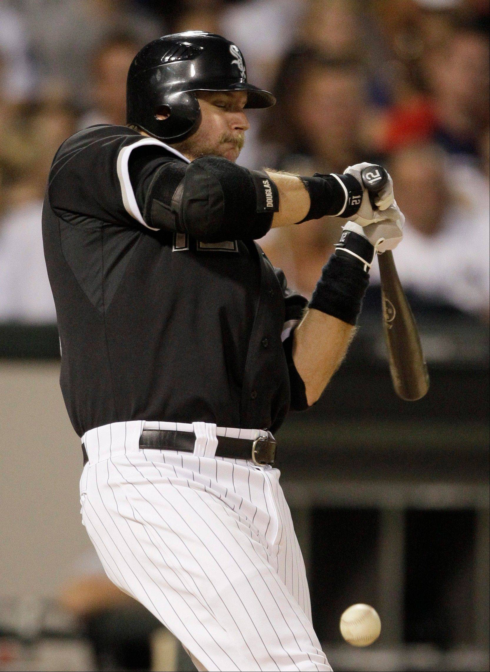 White Sox catcher A.J. Pierzynski reacts to getting hit by a pitch from Kansas City Royals starter Bruce Chen last Friday. The team put Pierzynski on the 15-day disabled list with a fractured left wrist.