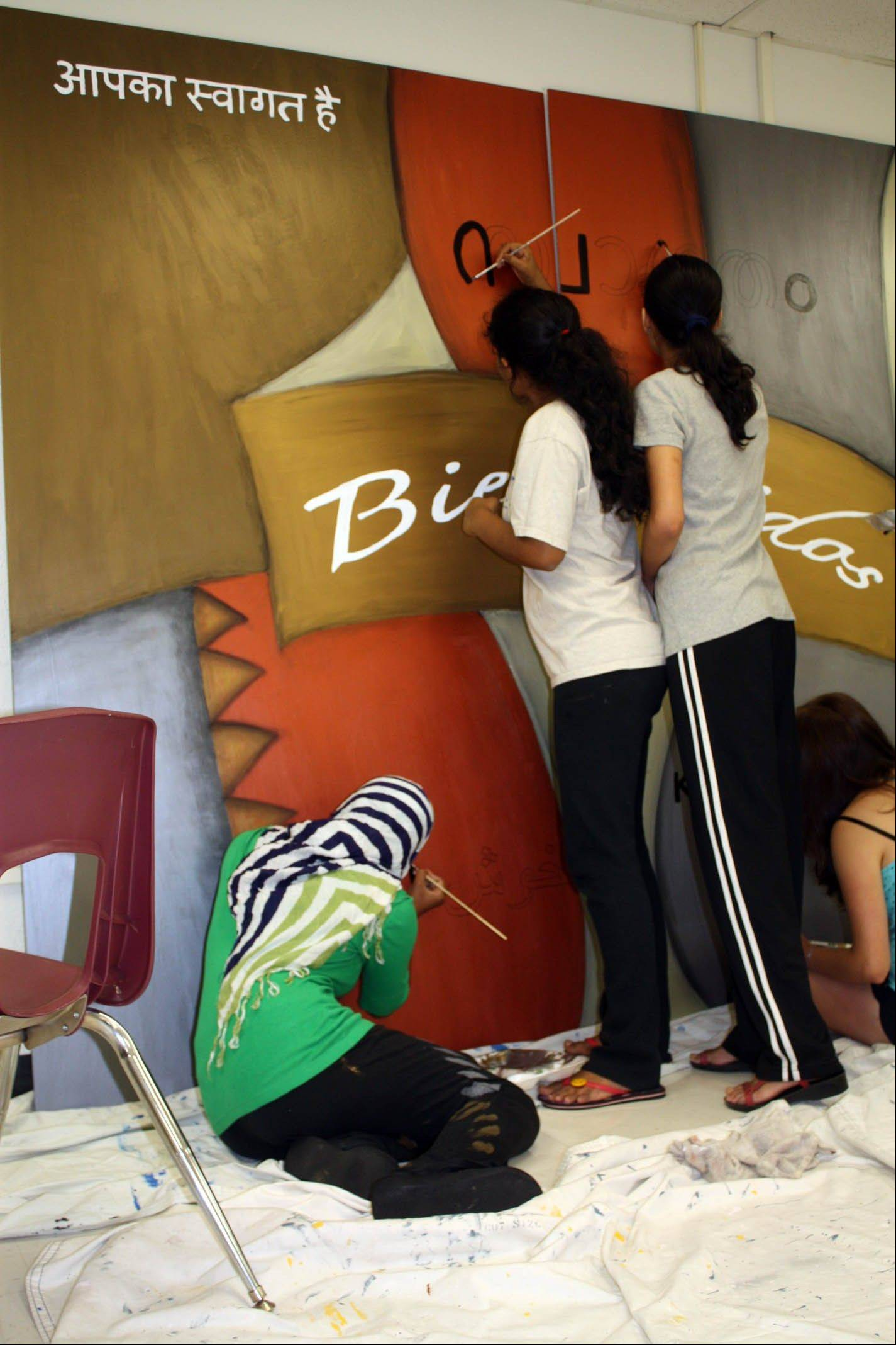 Maine East students work on the mural.