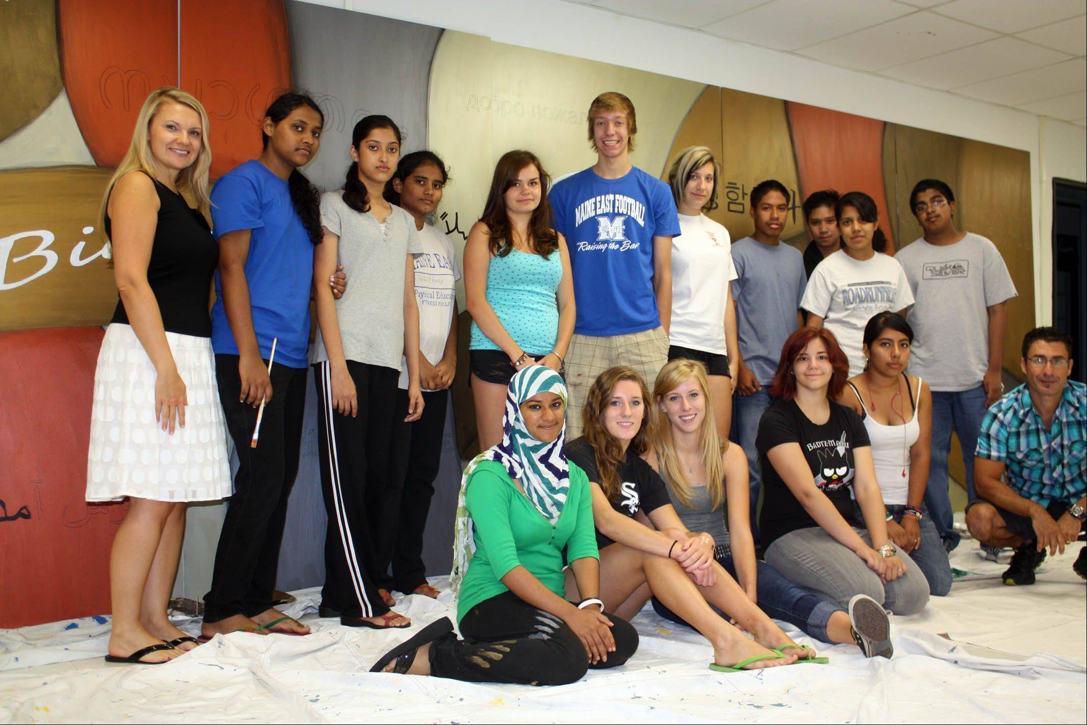 The team of Maine East students who worked on the mural, which is based on a Gino Savarino design.