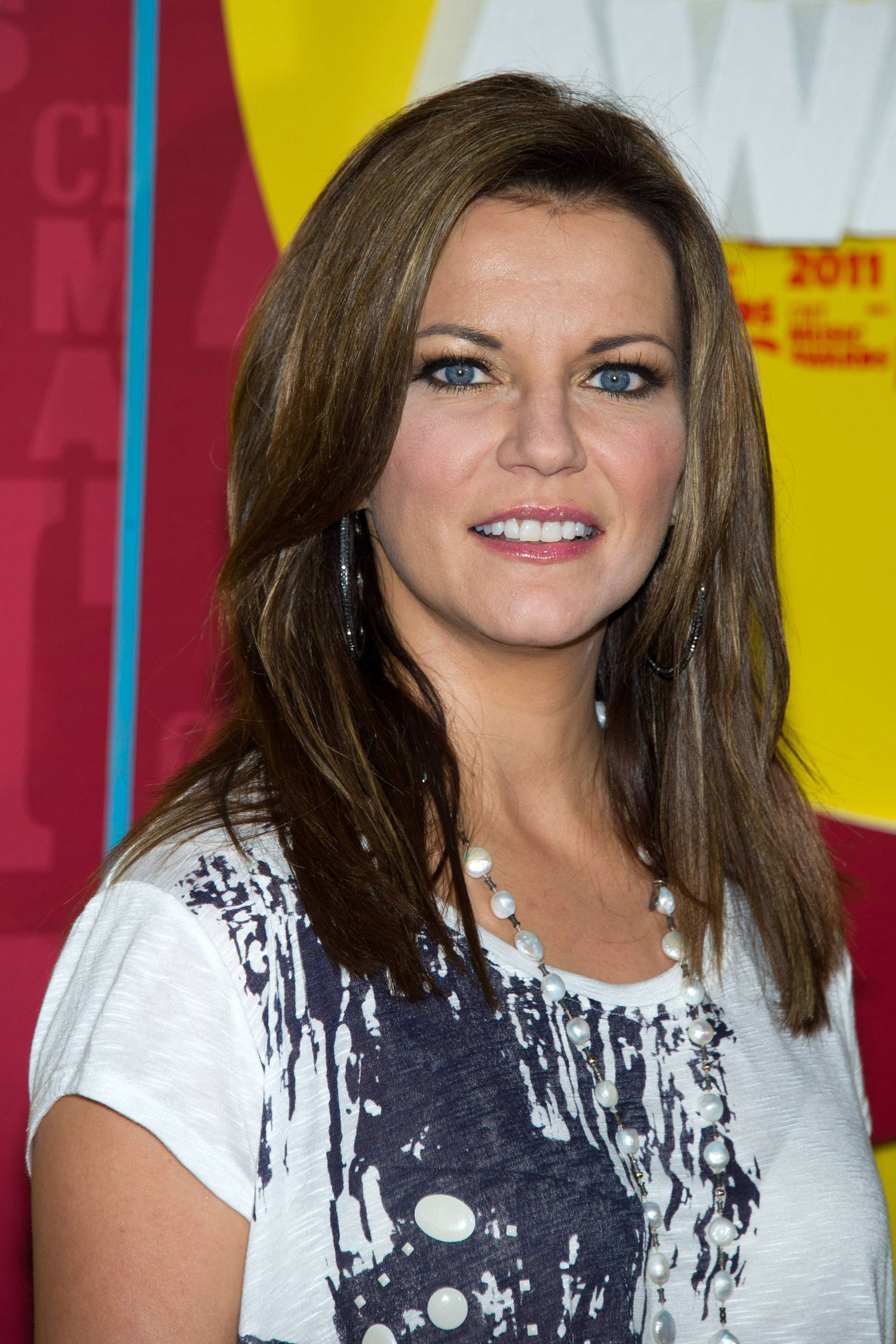 "Martina McBride enlisted some famous cancer survivors to appear in her new video for ""I'm Gonna Love You Through It,"" which debuts on CMT.com on Wednesday."