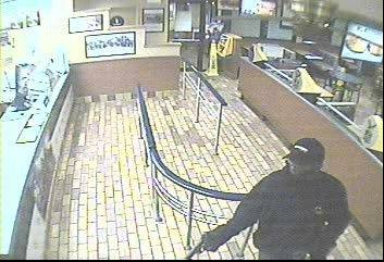 Bartlett police have released this photo from a July 24 armed robbery of a Burger King, asking for the public's help in tracking down the thief.
