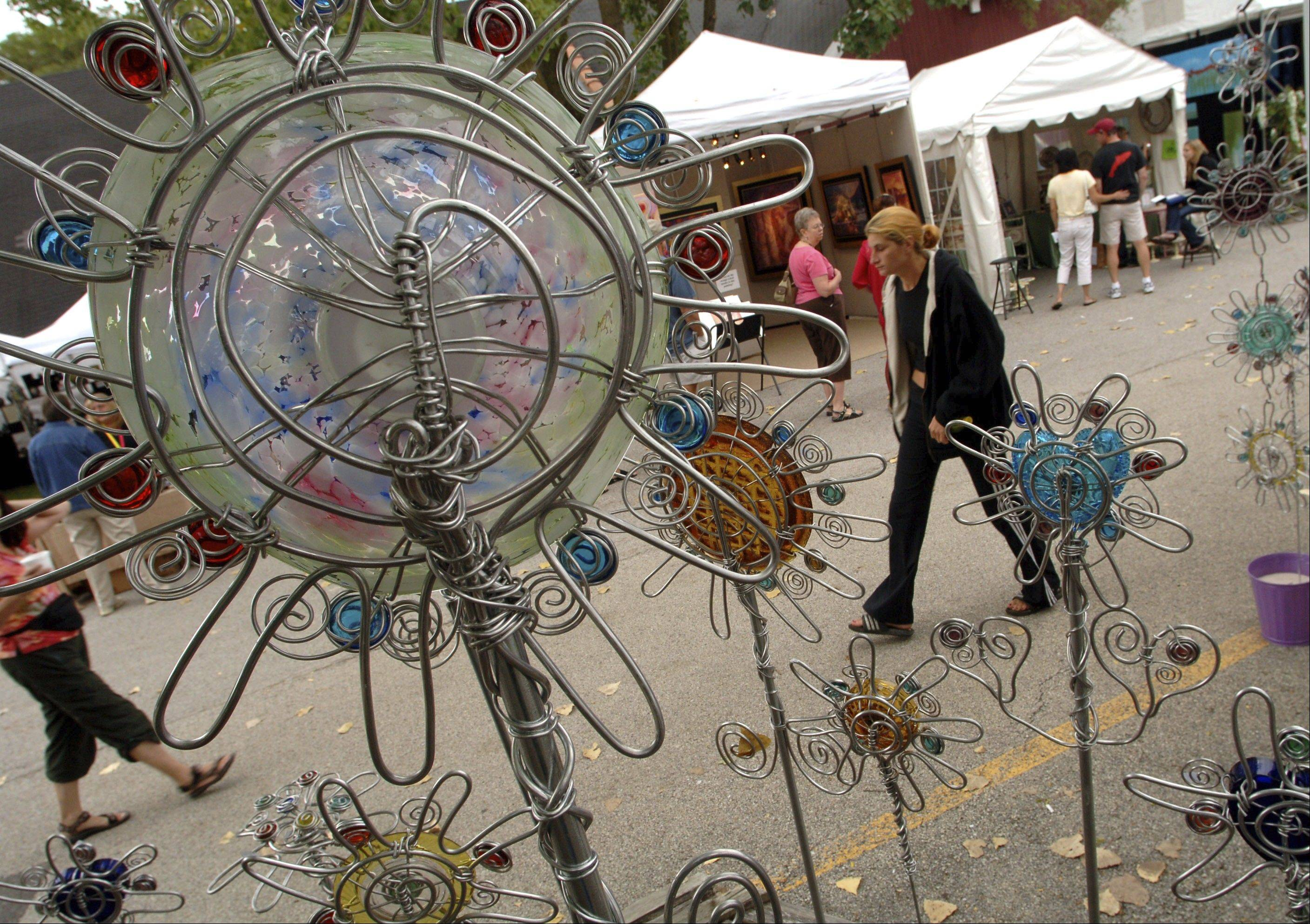 A selection of aluminum wire and glass bead art by Florida artists is displayed at the 19th annual Long Grove Art Fest.