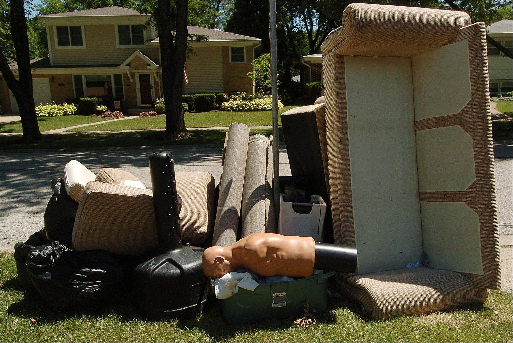 Furniture and other basement belongings damaged by floods were a common sight outside Mount Prospect homes after last month�s record rains. Now village officials are hiring an engineering firm to visit damaged homes and help determine how to reduce or prevent flooding in the future.