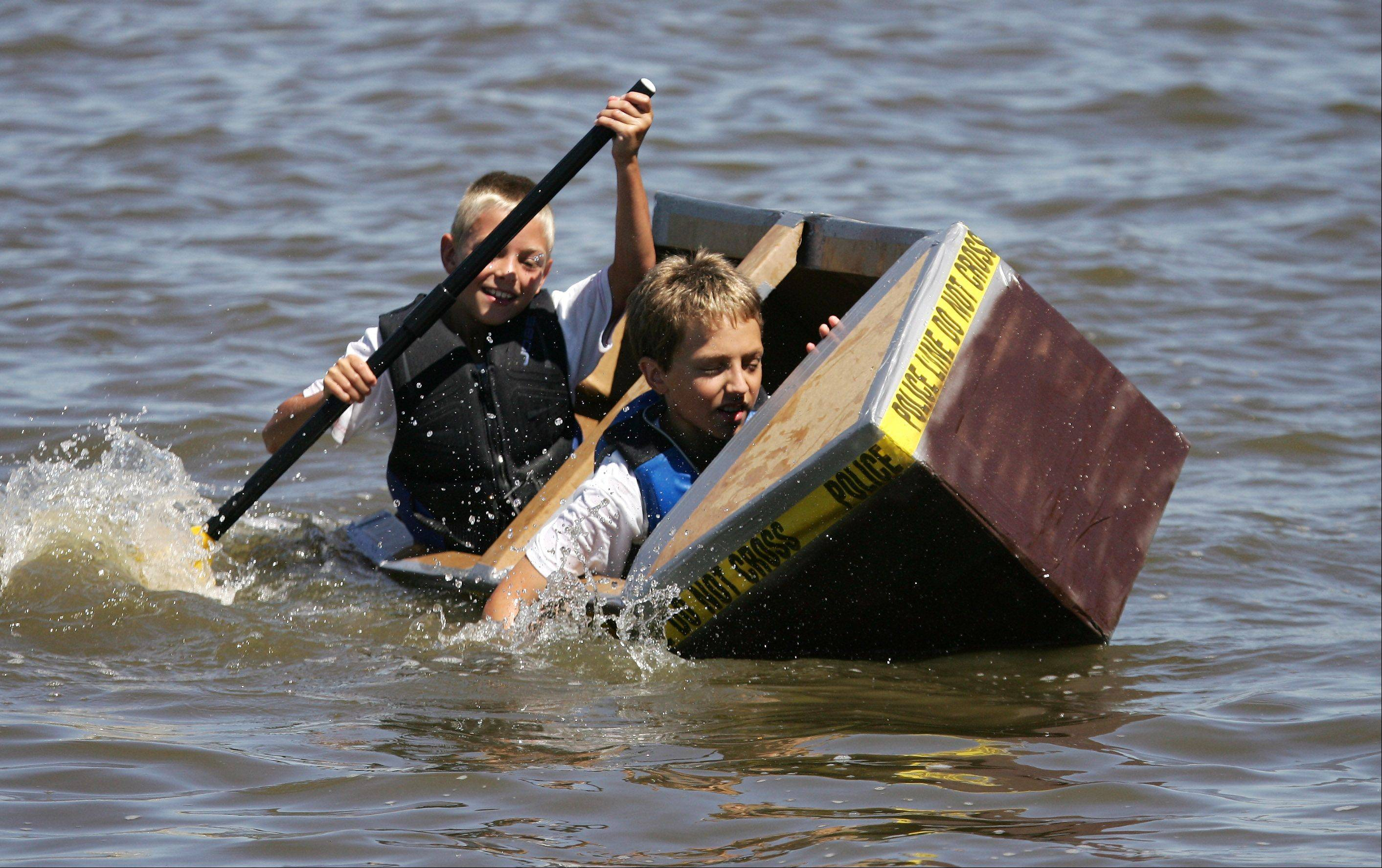 Kaden Kane, 9, and Max Myzka, 10, both of Palatine, participate in last year's Fox Lake Cardboard Boat Race.