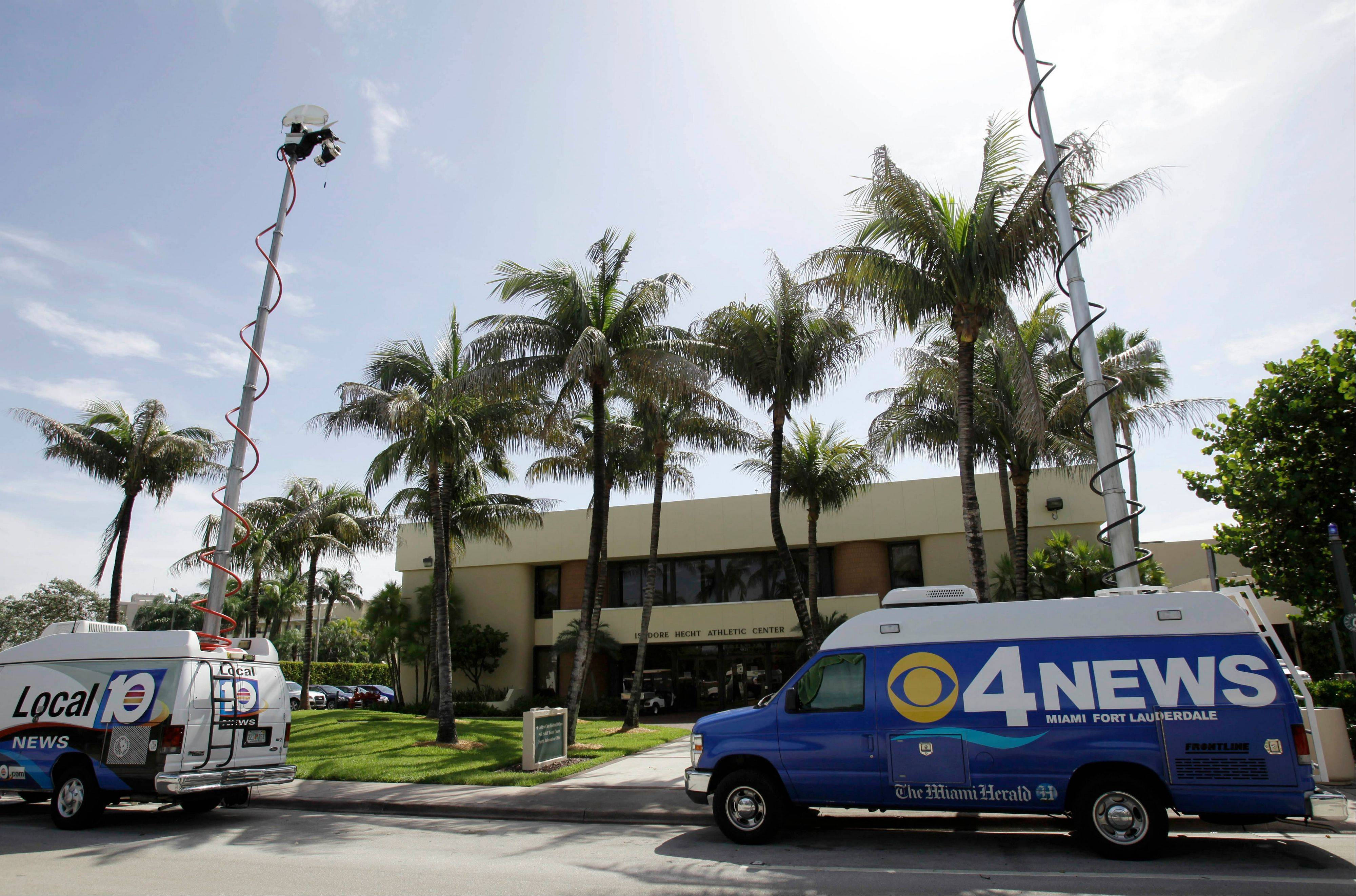 Television news teams flocked to the University of Miami Isadore Hecht Athletic Center in Coral Gables., Fla., Wednesday to get reaction to a Yahoo! Sports report that former booster Nevin Shapiro treated football players with sex parties, nightclub outings, cars and other cash gifts. NCAA investigators also were on campus this week to investigate the claims.