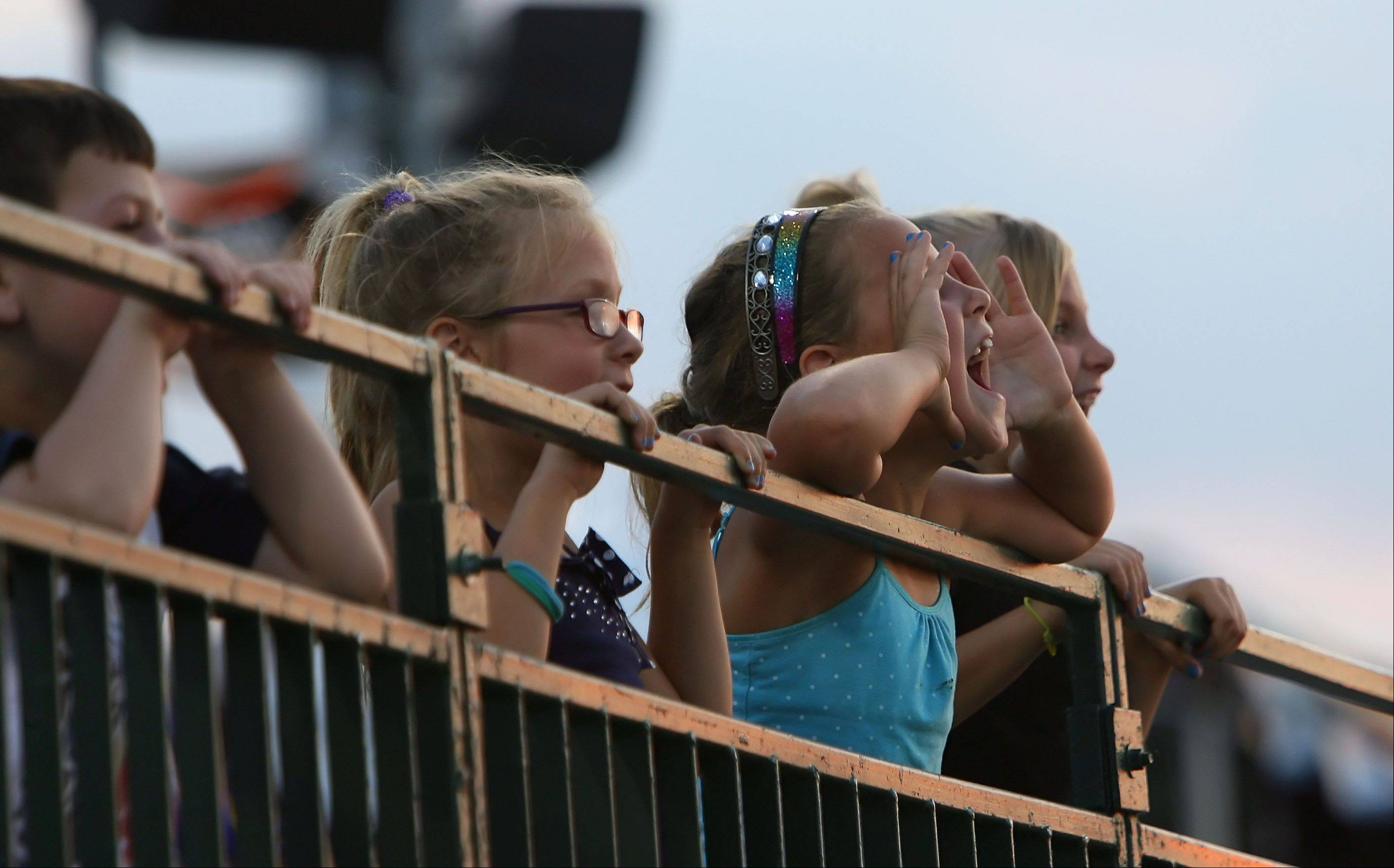 Kids cheer on their friends as they race the bases in between innings during the Lake County Fielders game Wednesday night.