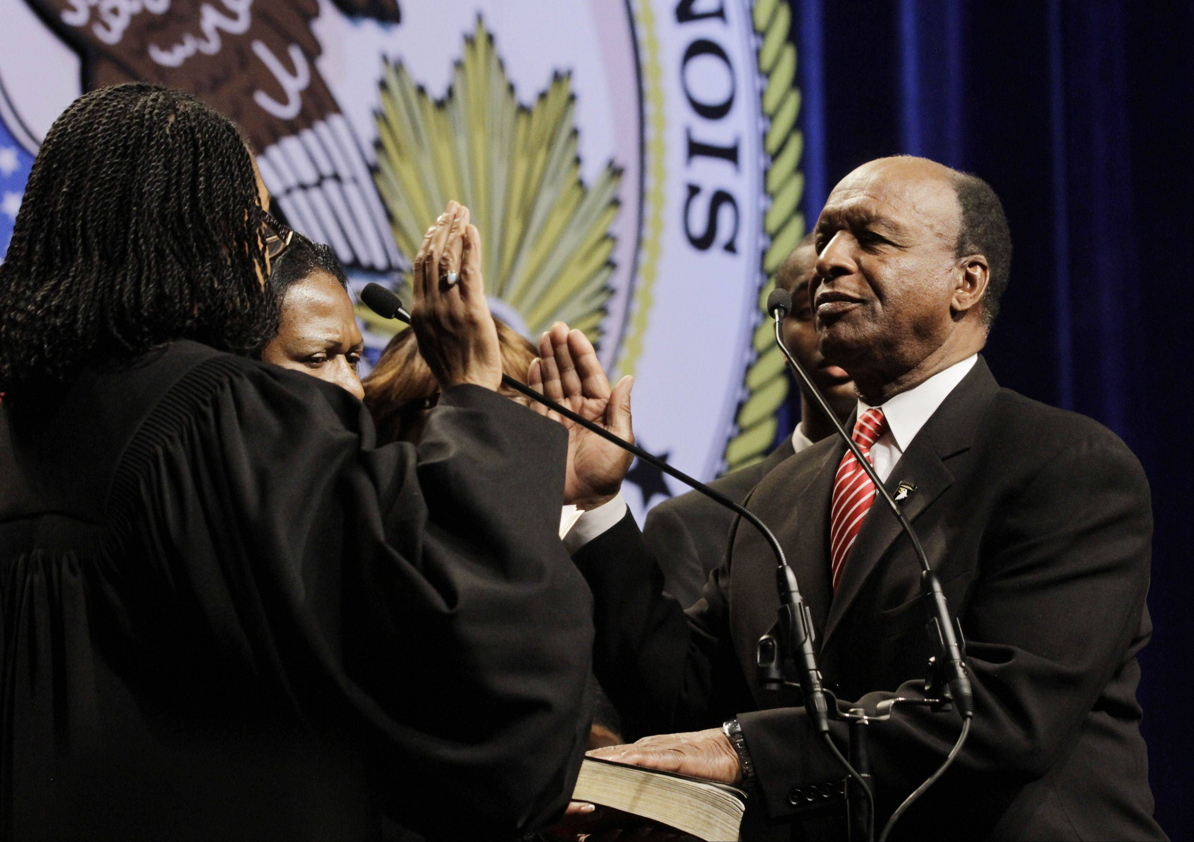 Secretary of State Jesse White takes the oath of office on Jan. 10, 2011, in Springfield. The 77-year-old Democrat announced Wednesday that he'll seek a fifth term in 2014.