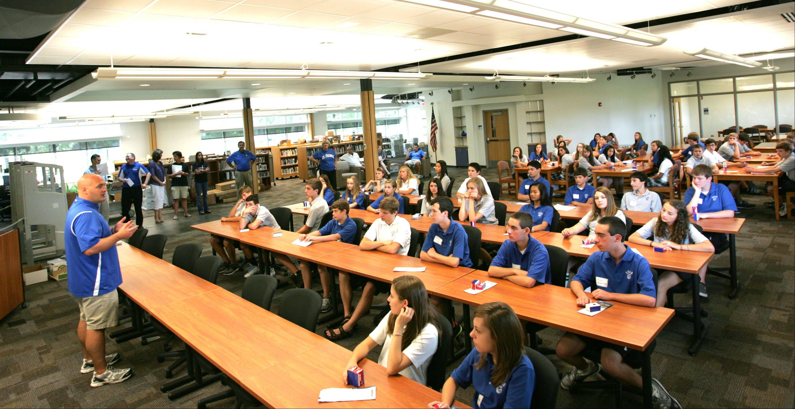 Freshmen attend an orientation session in the new resource center at Wheaton's St. Francis High School. The center and a science suite that's opening this fall are part of a $7 million addition and renovation project at the school.