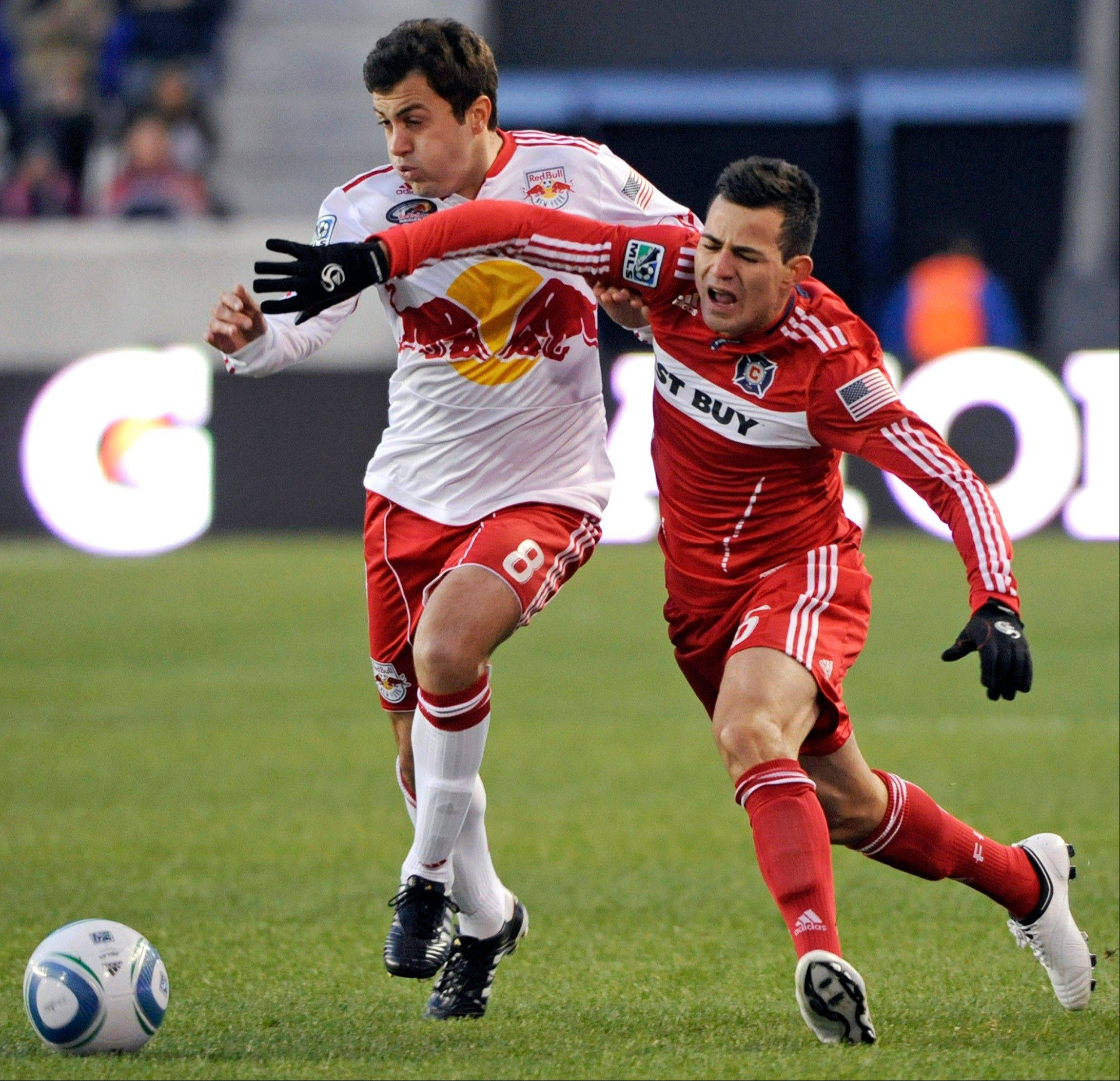 Chicago Fire midfielder Marco Pappa, right, said he is happy to be playing with a MLS club. Pappa has one more year left on his four-year contract.