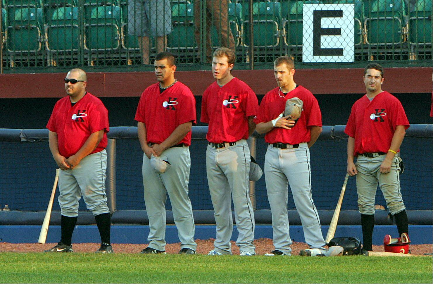 Members of a baseball team identified as the Kenosha County Fielders pause for the national anthem before playing the Lake County Fielders on Wednesday in Zion. The Kenosha squad consists of semipro players from several teams, a spokesman for the Lake County ballclub said.