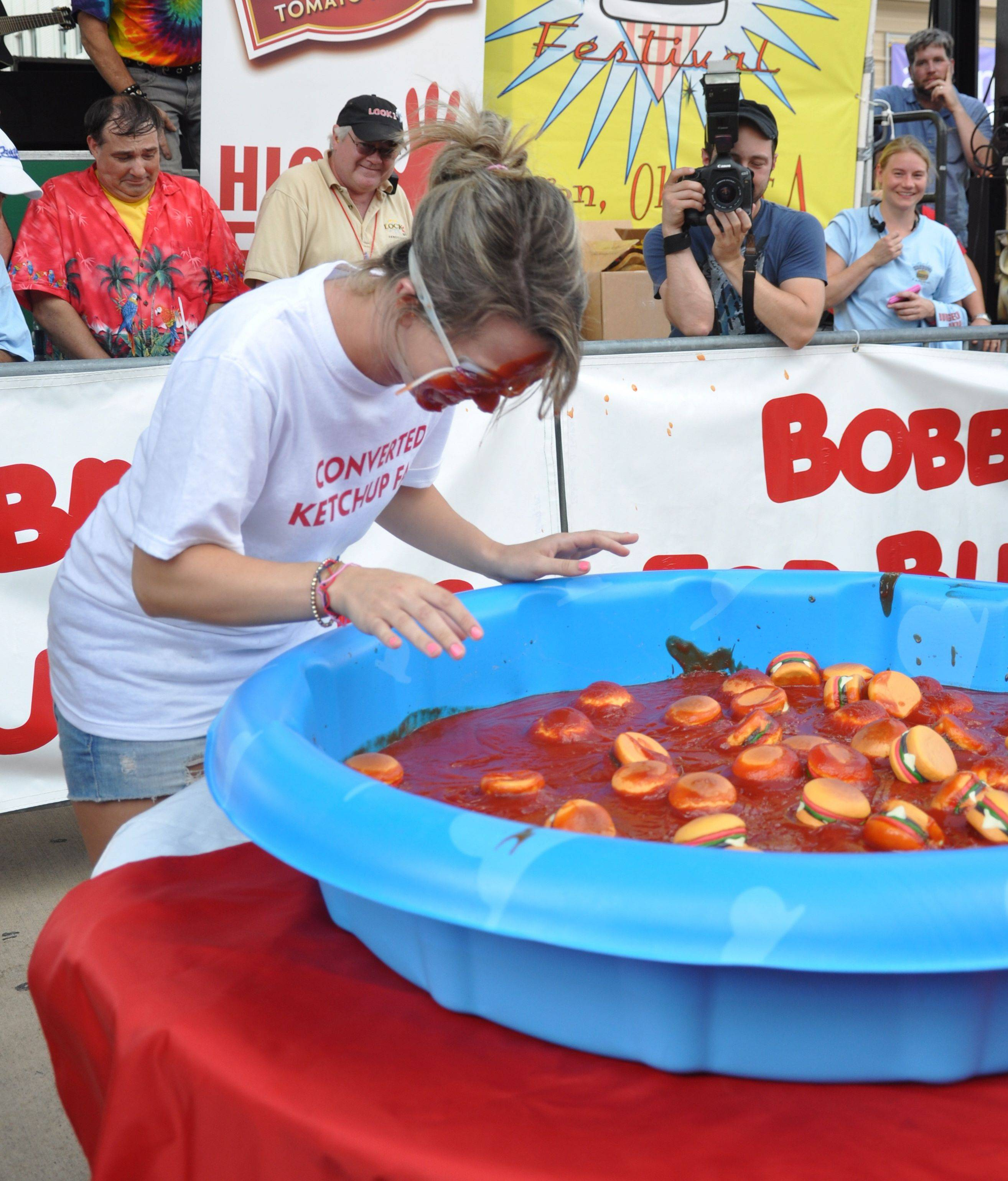 The Bobbing for Burgers contest is one of the competitions featured at the National Hamburger Festival in Akron, Ohio.