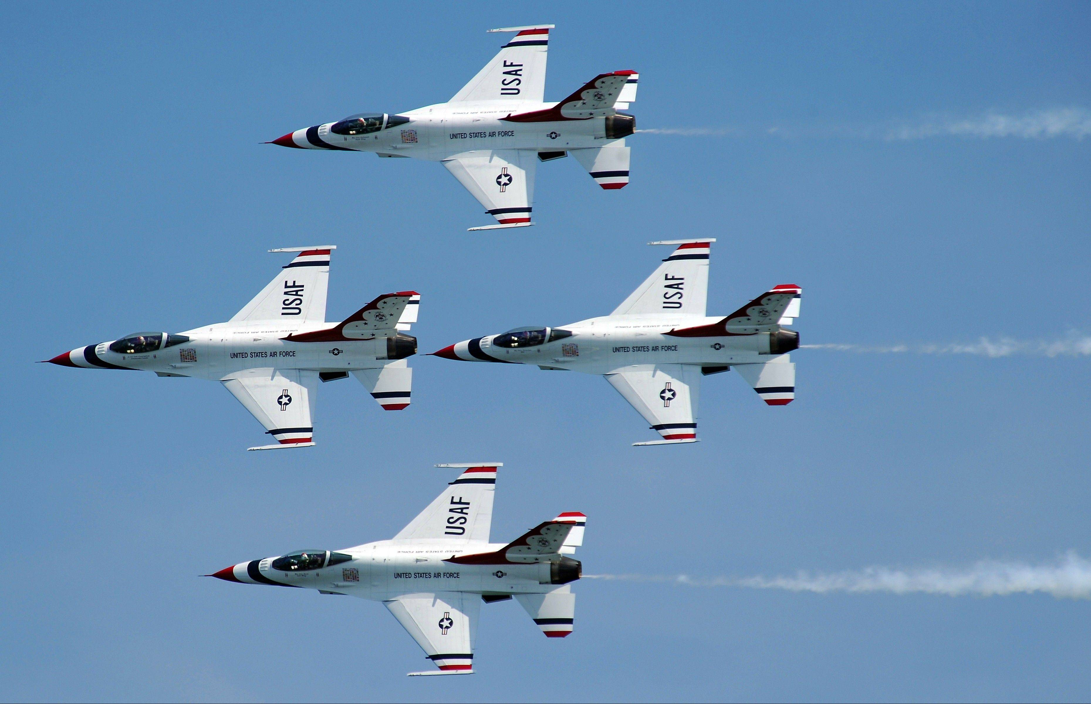The U.S. Air Force Thunderbirds soar through the sky in tight formation.