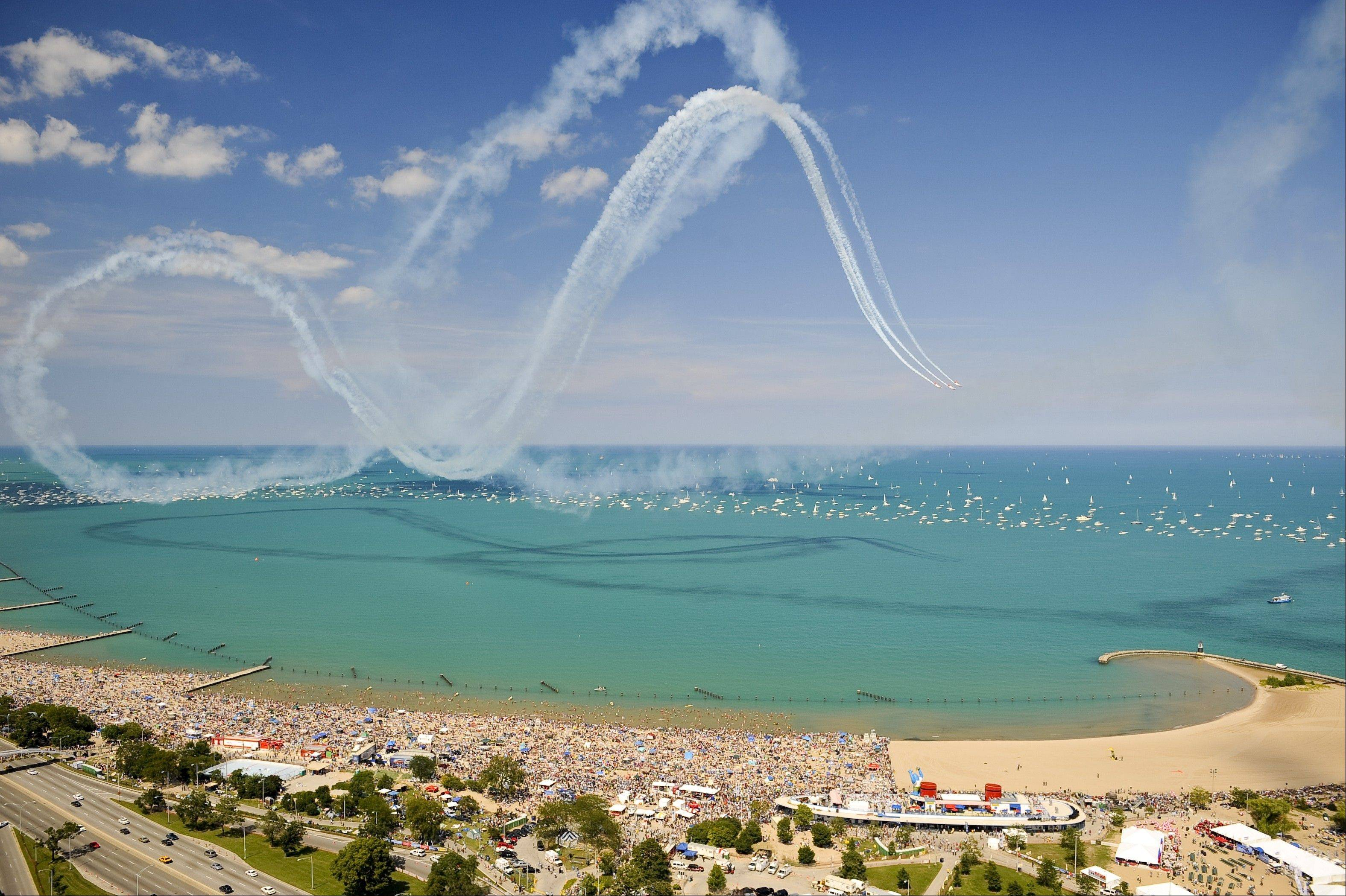 Stripes of smoke fill the skies over North Avenue Beach for the Chicago Air & Water Show. The show draws up to 2 million people to the lake -- and local rooftops -- each summer.