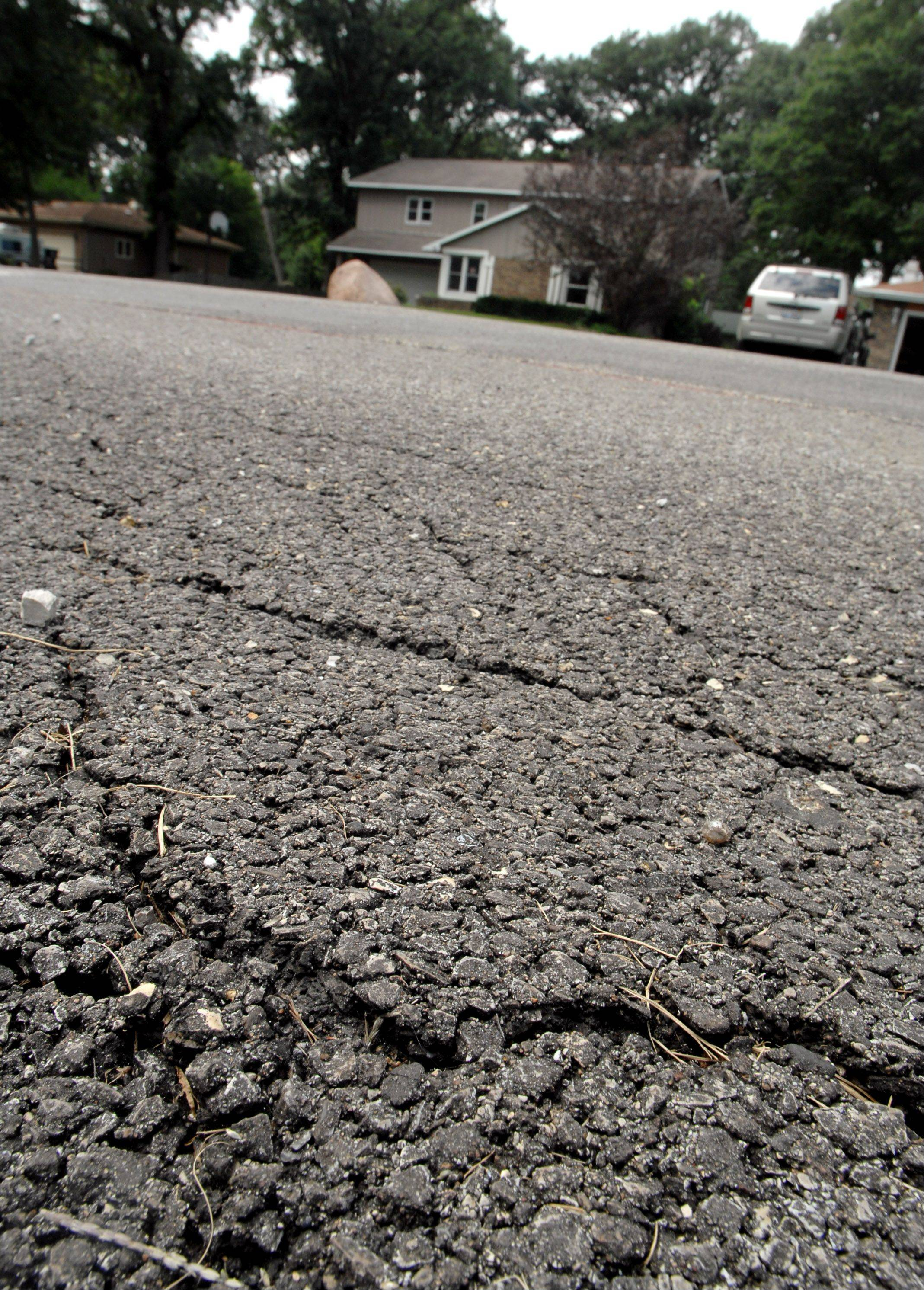 Homeowners near Port Barrington are complaining that shoddy roadwork quickly deteriorated into sunken and cracked pavement on their Geraldine Lane dead-end street and are pressuring Wauconda Township officials to have the work redone.