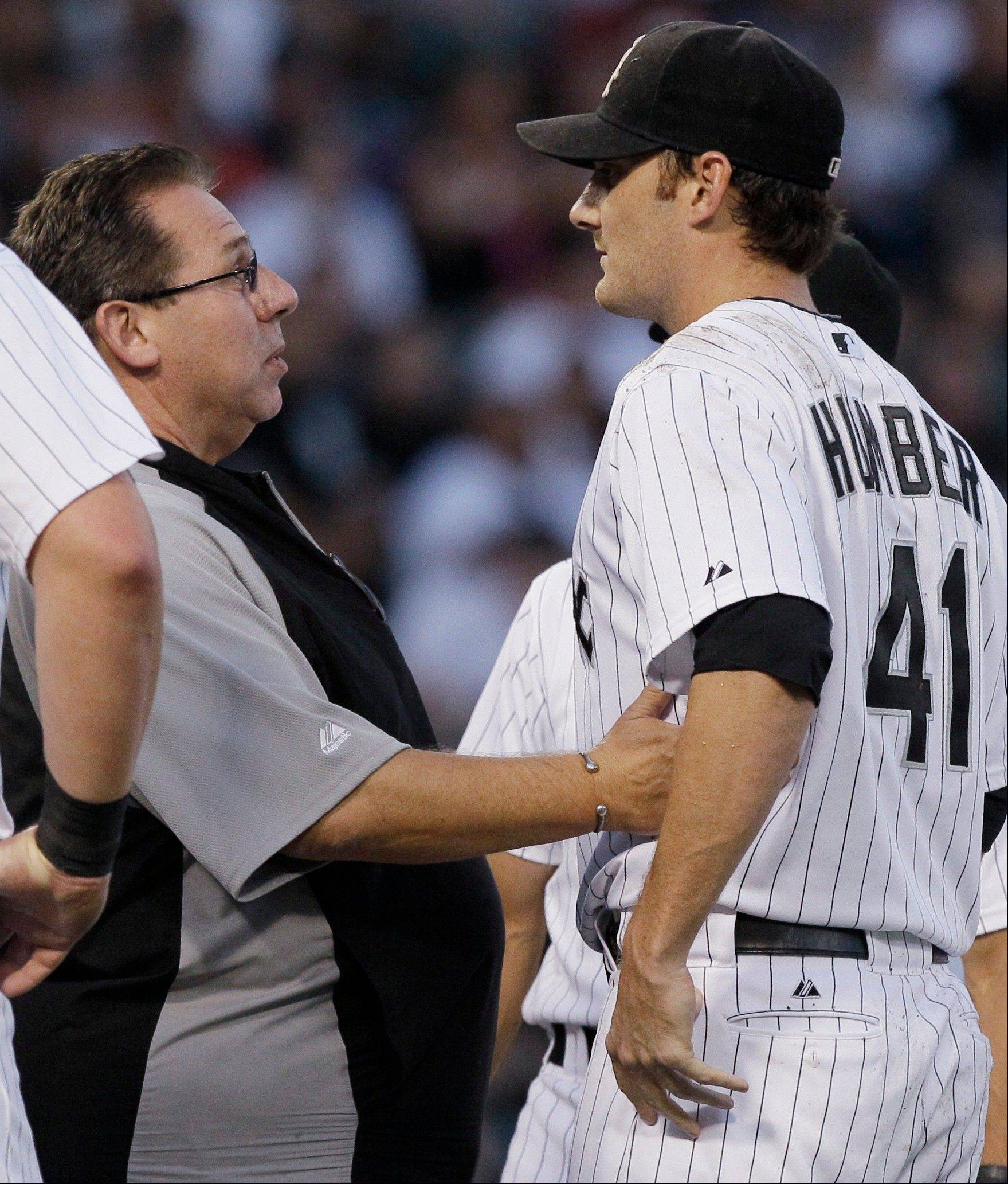 Associated PressPhil Humber is examined by a White Sox trainer Herm Schneider after being hit in the head by a liner from the Indians' Kosuke Fukudome.