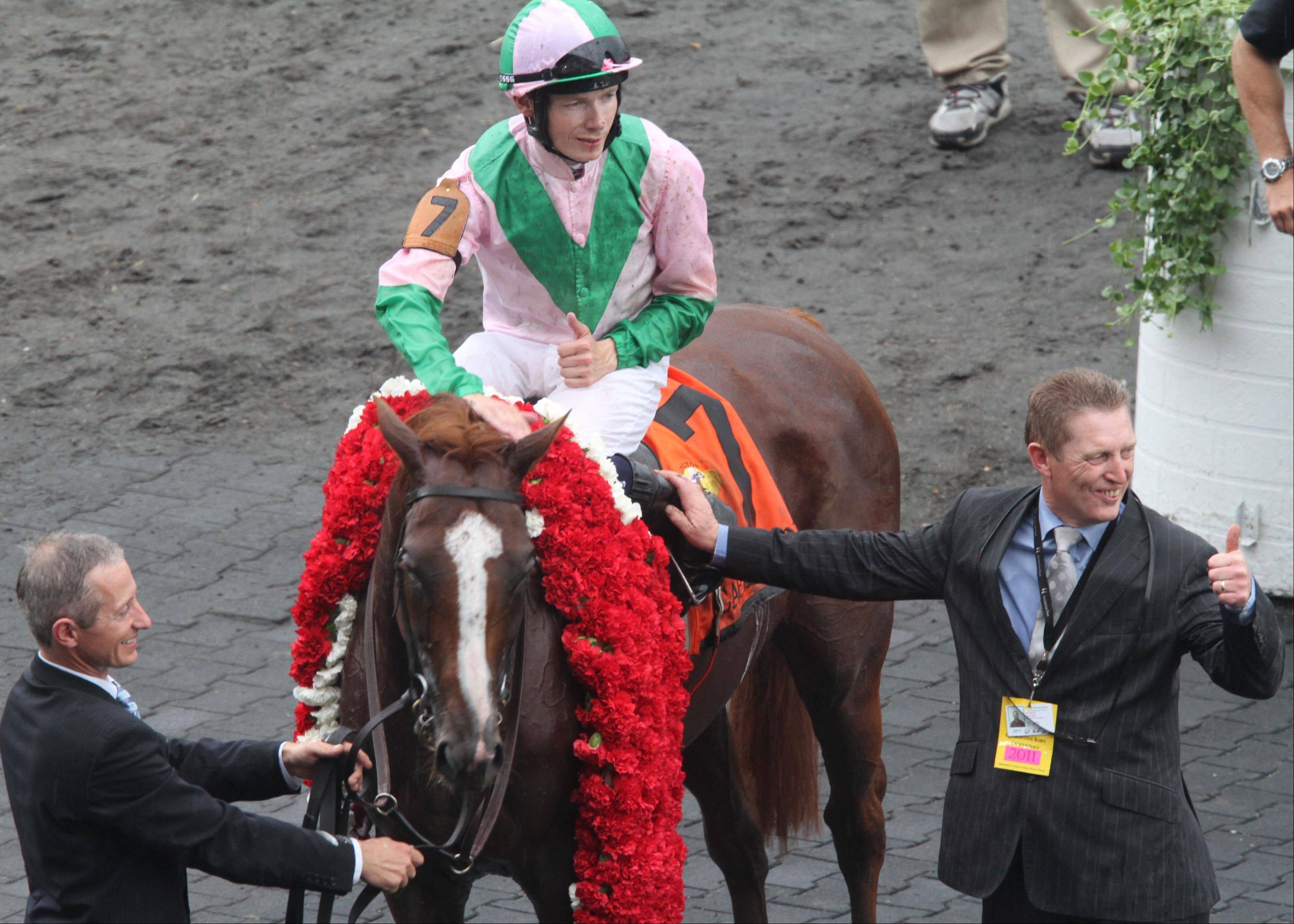 Jamie Spencer, riding Cape Blanco, wins the Arlington Million at Arlington Park on Saturday.