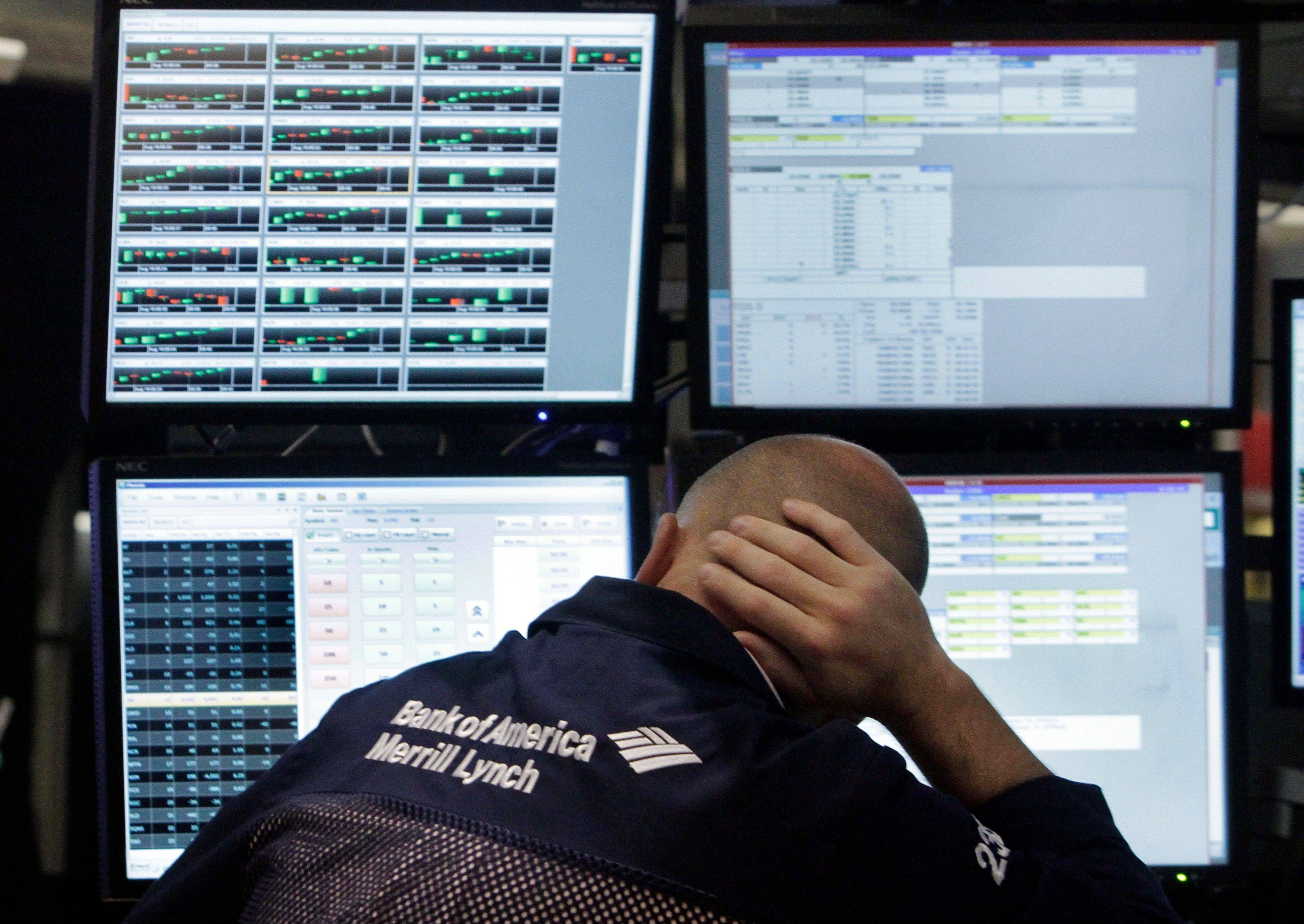 Specialist Michael O'Connor works at his post on the floor of the New York Stock Exchange on Friday. The Dow lost 172.93, or 1.6 percent, and closed at 10,817.65.