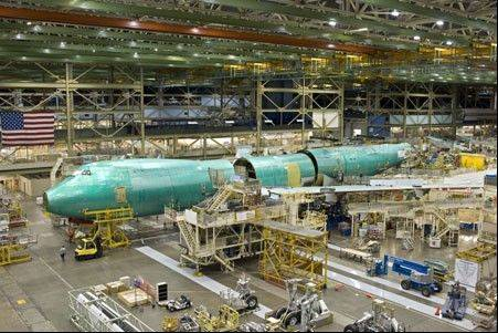 After a two-year delay Chicago-based Boeing Co.'s new 747-8 freighter, the biggest plane it's ever built, won certification from the U.S. Federal Aviation Administration to enter commercial service. Associated Press
