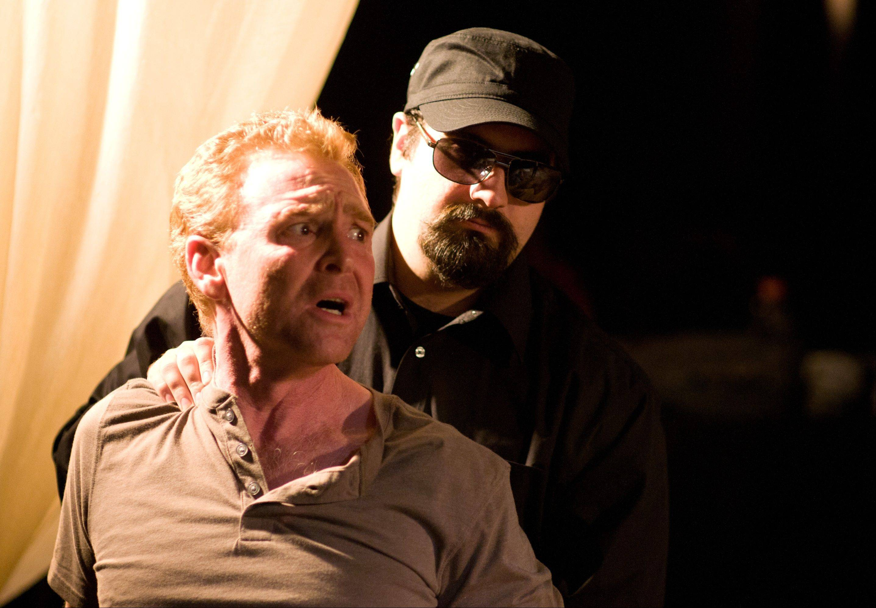 Caleb Donat, left, as the ill-treated Antonio, is among the standouts in Janus Theatre's production of
