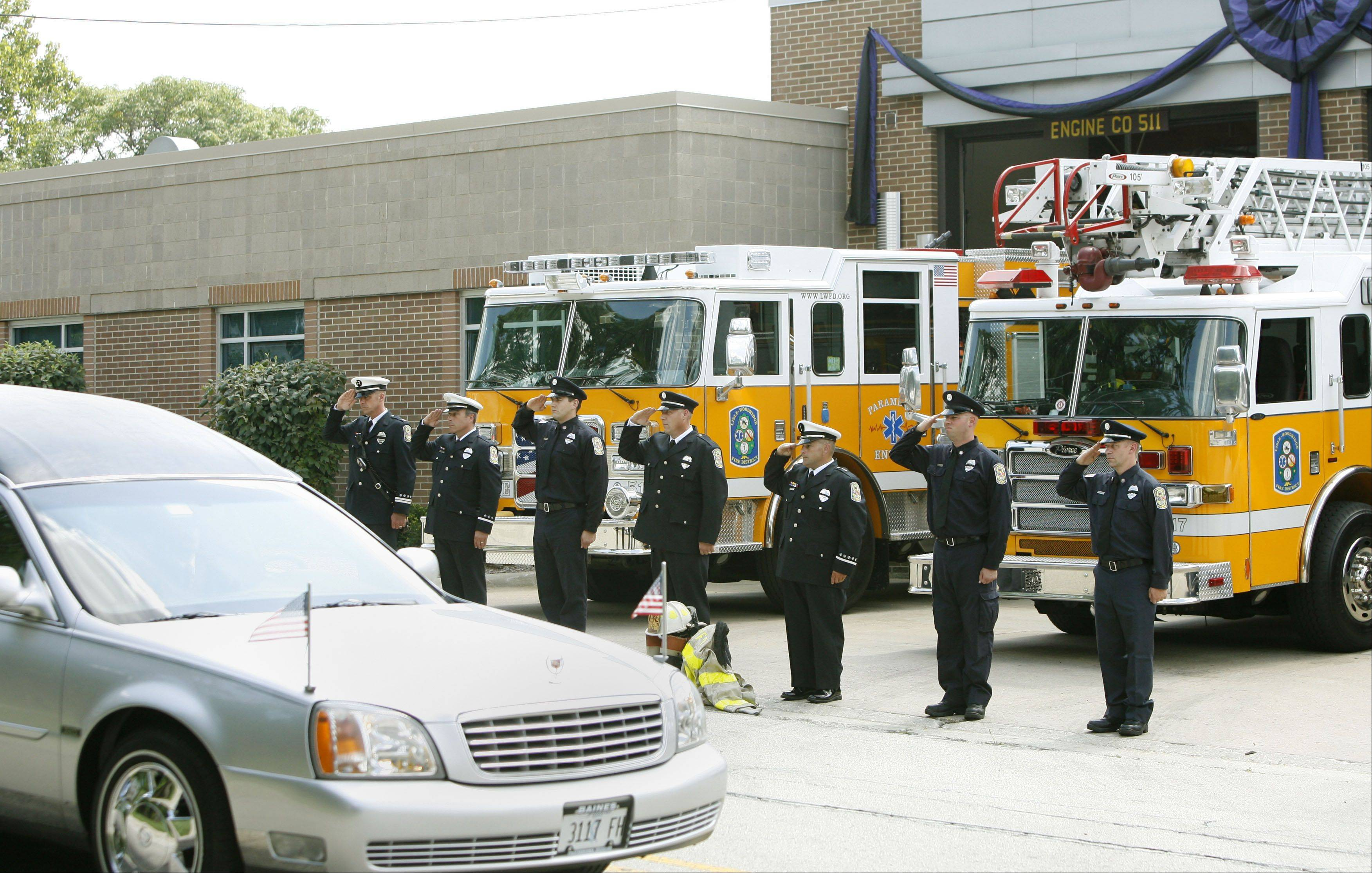 "Members of the Lisle-Woodridge Fire Protection District gather Friday to say goodbye to former chief Paul H. ""Bud"" Boecker."
