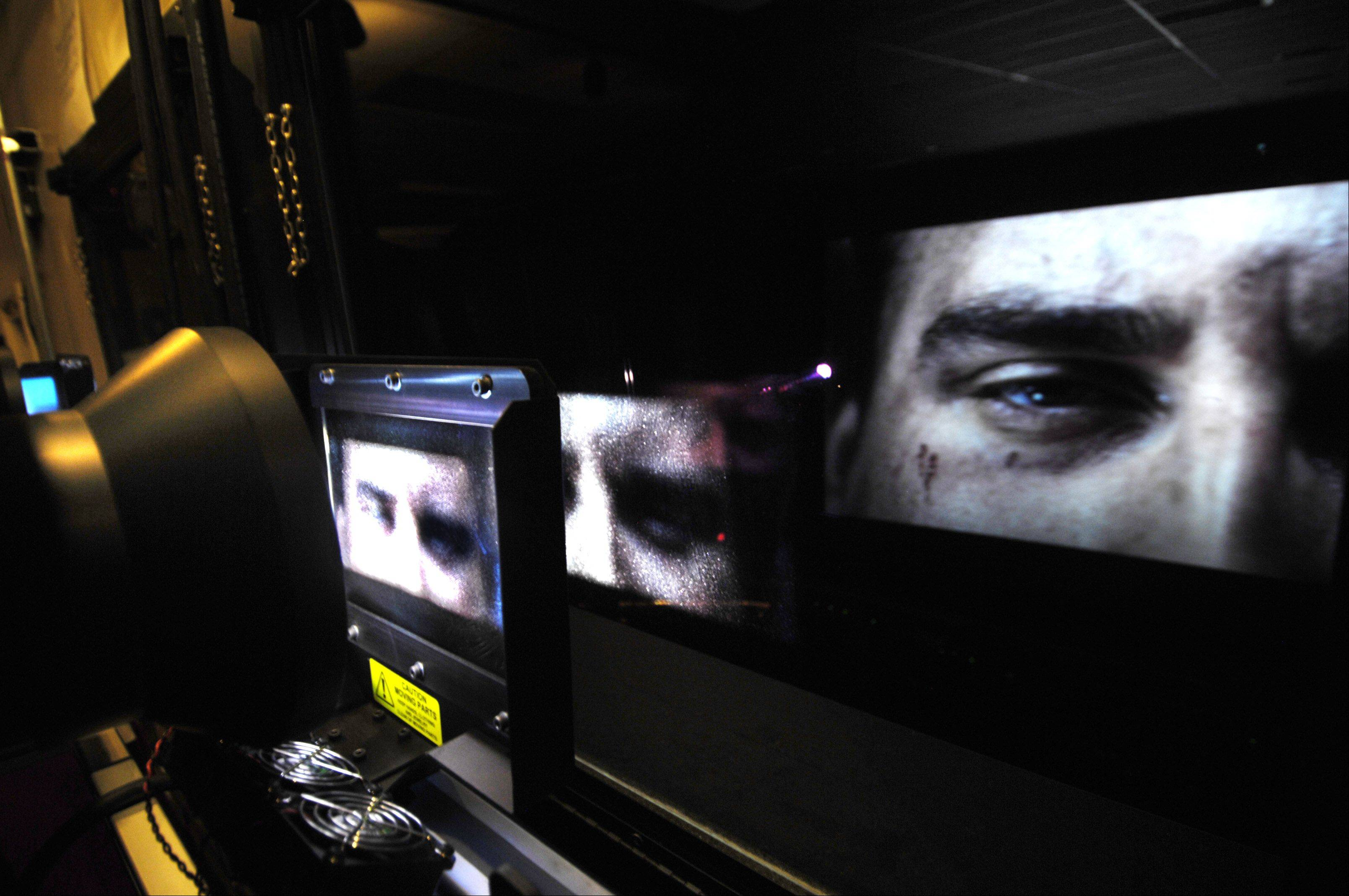 The movie image is projected through a polarized lens in the projection booth. Coupled with the polarized IMAX movie glasses worn by viewers, a 3-D image is created.