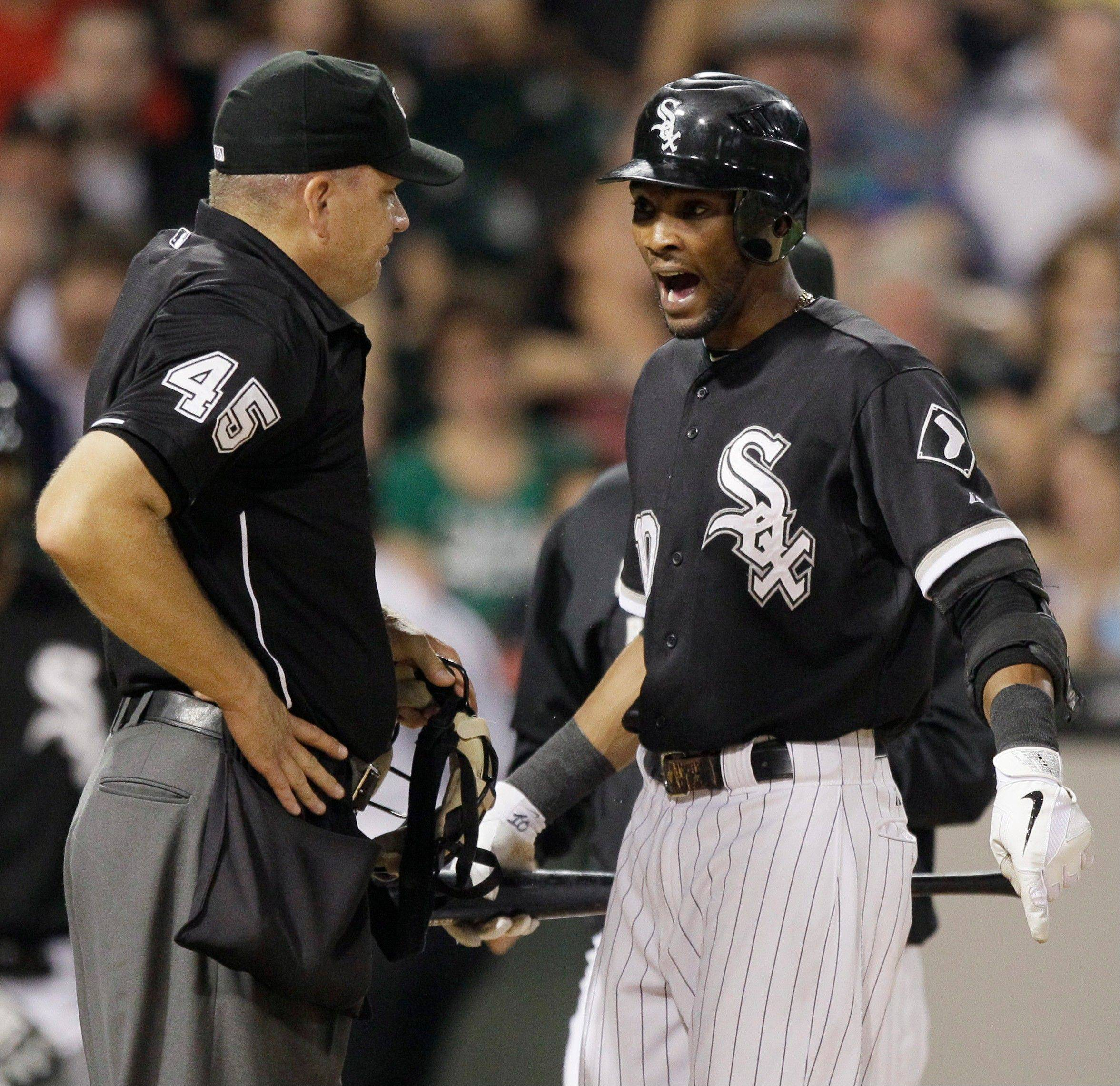 Chicago White Sox's Alexei Ramirez, right, argues with home plate umpire Jeff Nelson during the eighth inning against the Texas Rangers in Chicago. Ramirez was ejected by Nelson.