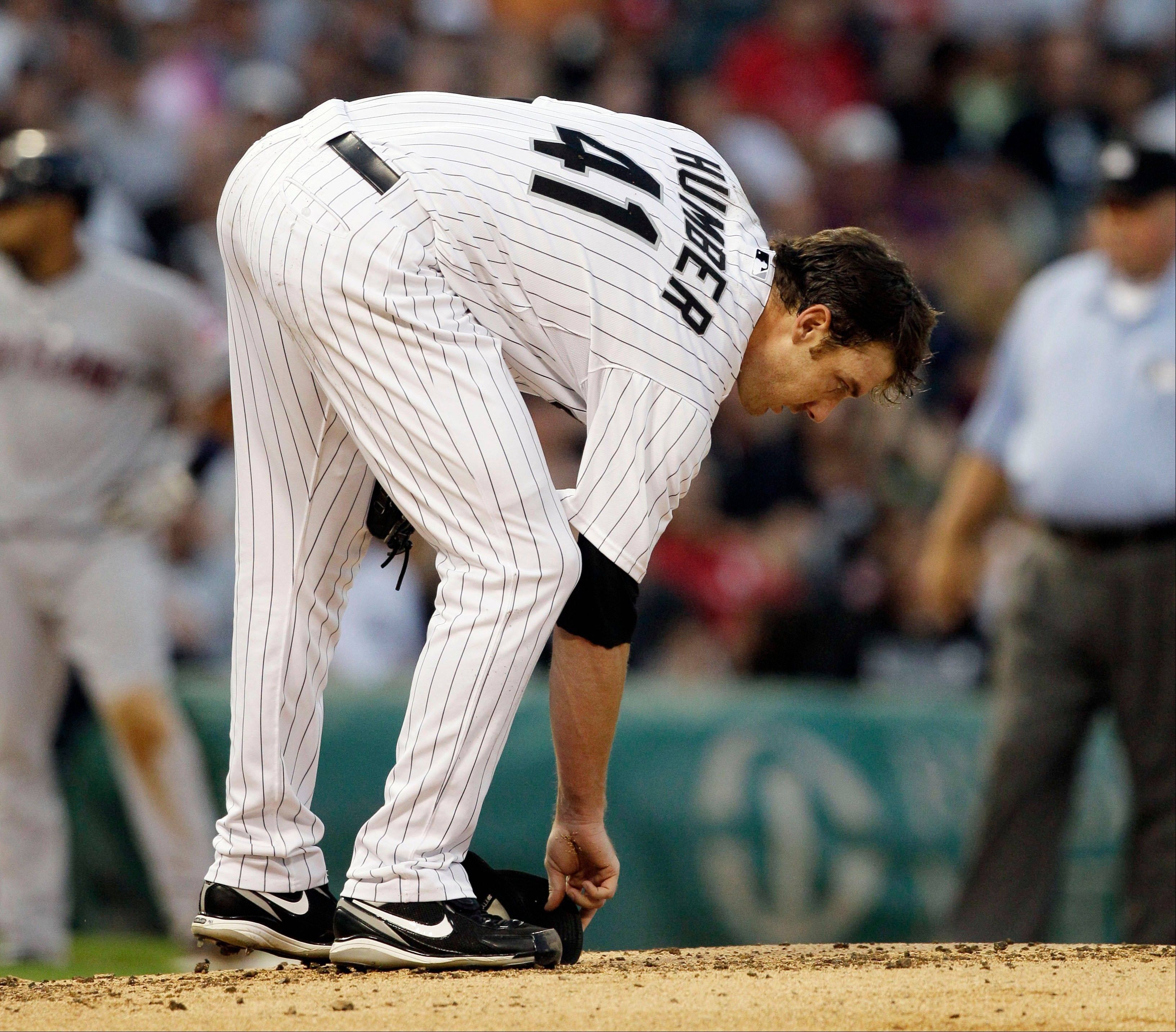 White Sox starter Phil Humber grabs his baseball cap after being hit by line drive off the bat of Cleveland Indians' Kosuke Fukudome during the second inning Thursday. The Sox placed Humber on the 15-day disabled list.