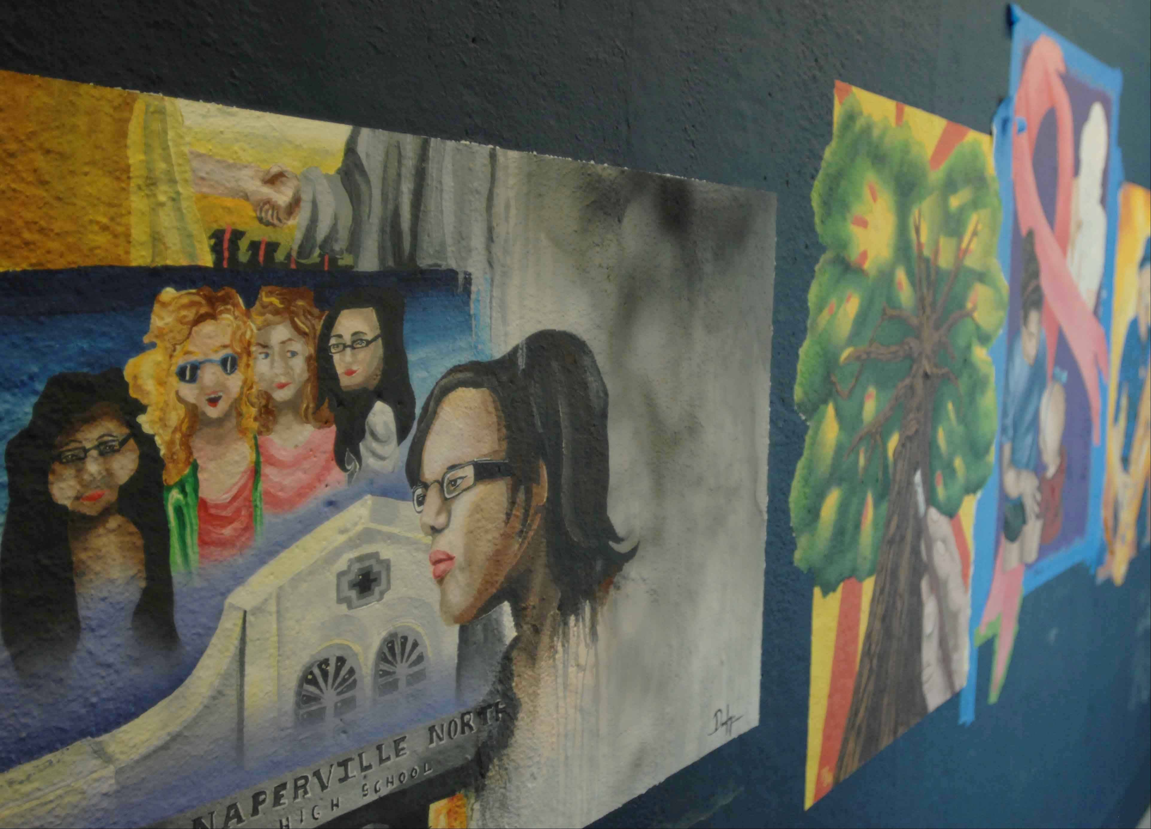 The fourth floor elevator lobby of the Van Buren parking garage is decorated with murals painted by Naperville North High School students.