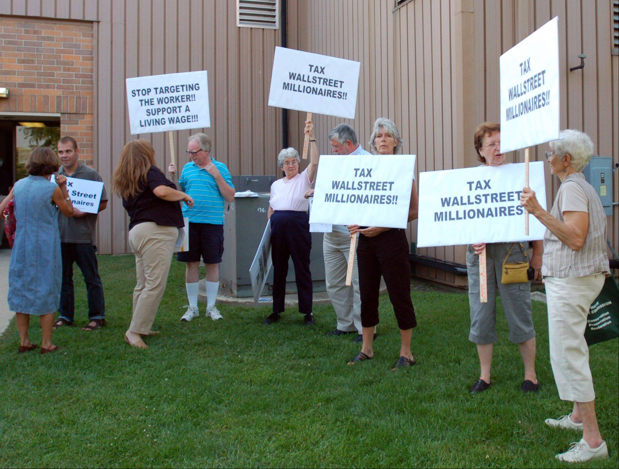 Protesters rallied before the town hall meeting with Congressman Randy Hultgren at the Geneva Public Works Facility on Thursday.