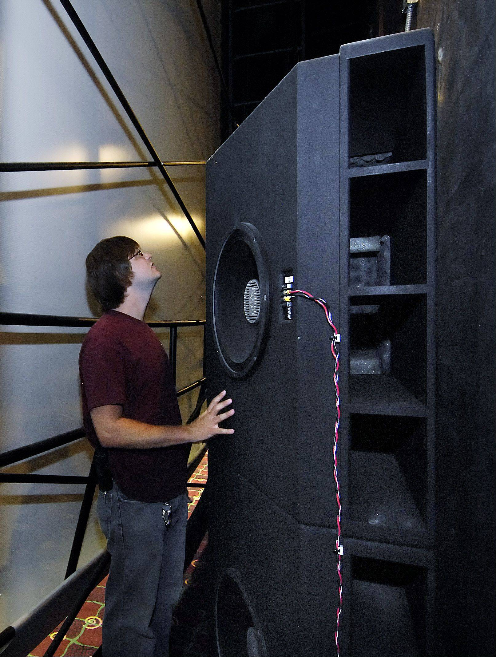 The woofers, or speakers that deliver the thumping low bass sound, are more than 7 feet tall and are stacked behind the middle of the IMAX screen.