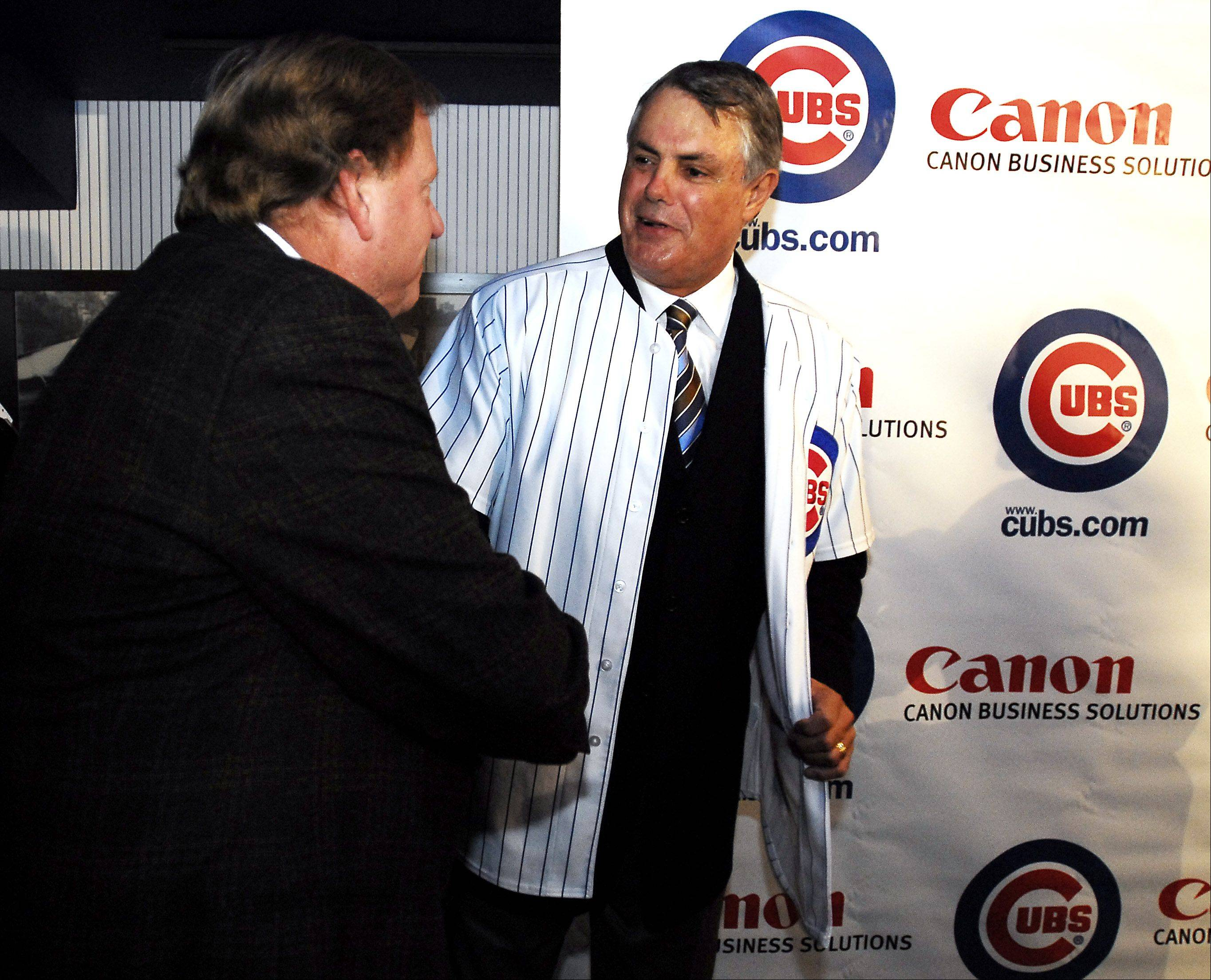 Chicago Cubs welcome new manager Lou Piniella to the club. Cubs General Manager Jim Hendry (left) and Lou Piniella shake hands after the news event.